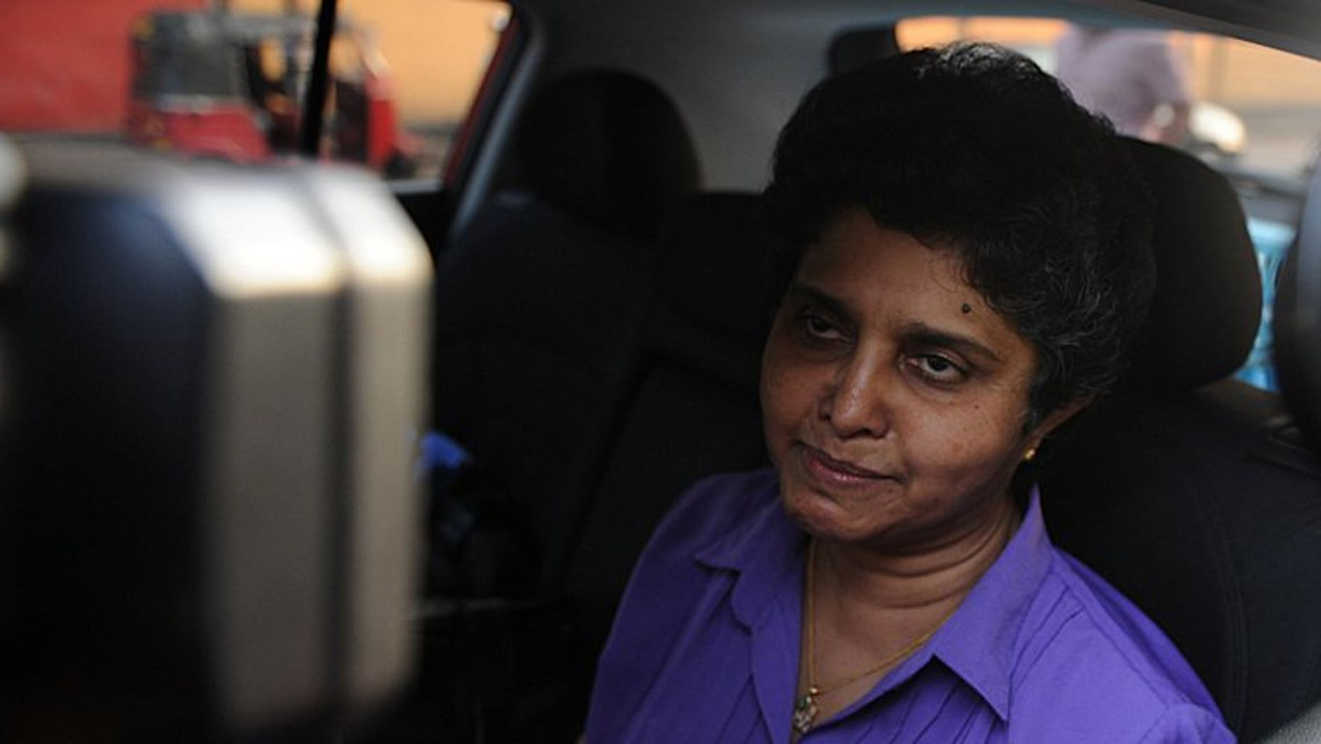 Sri Lanka's former chief justice Shirani Bandaranayake leaves her official residence in Colombo, on January 15, 2013. Sri Lanka has brought criminal charges of corruption against Bandaranayake whose sacking earlier this year was internationally criticised as a blow to judicial independence.