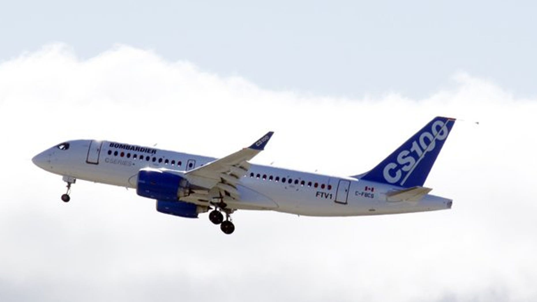 The new Bombardier aircraft CS100 is shown in Mirabel, Quebec after taking off for the first time on September 16, 2013.