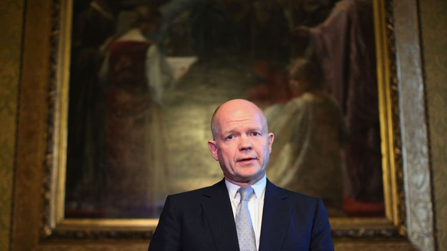 British Foreign Secretary William Hague addresses the media in the Foreign and Commonwealth Office on September 16, 2013 in London.