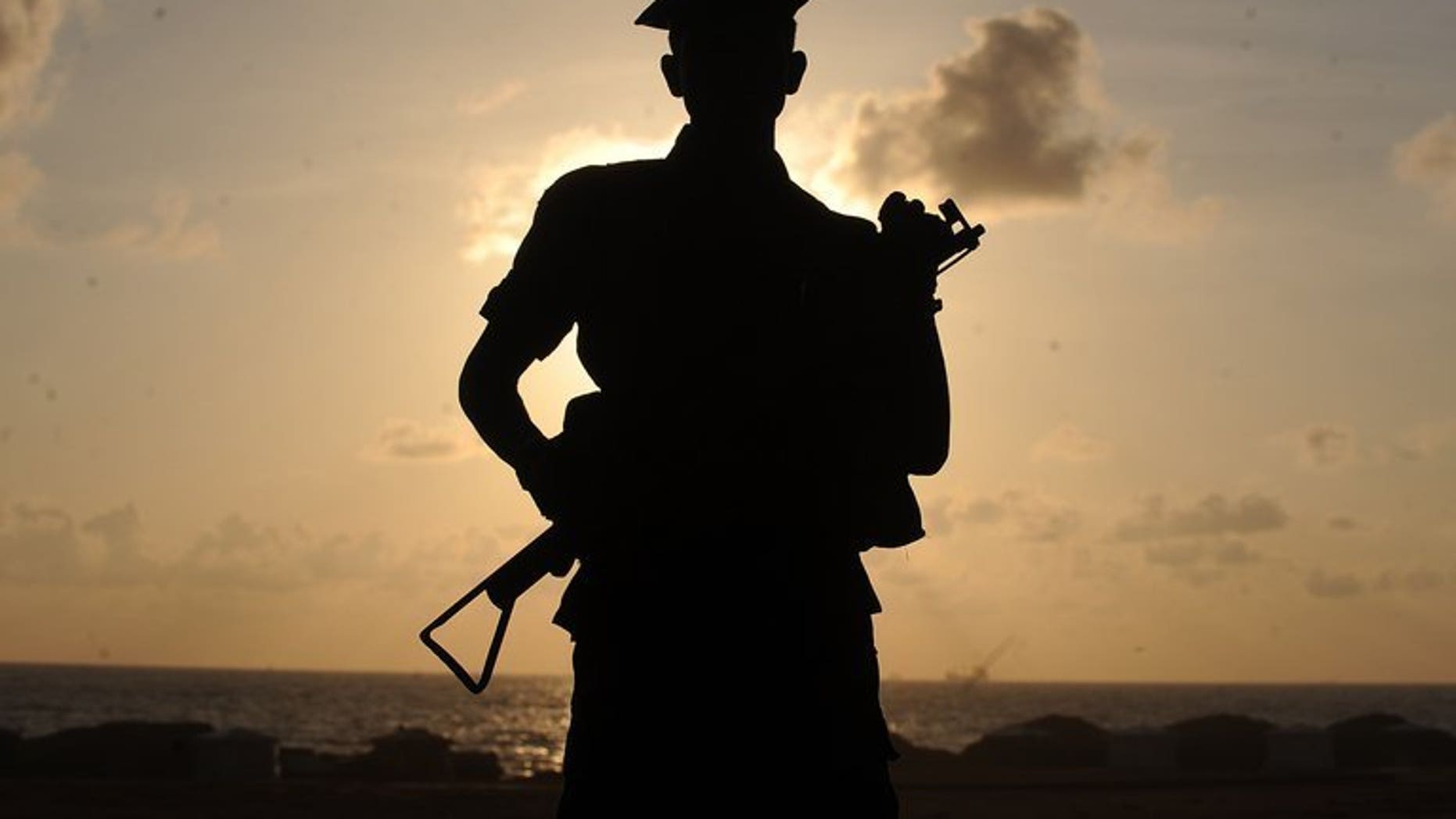 A Sri Lankan soldier stands guard on the seaside in Colombo, on May 16, 2012. Foreign observers have held talks with officials and candidates in Sri Lanka's former war zone to ensure the region's first elections to choose a semi-autonomous council pass off peacefully.