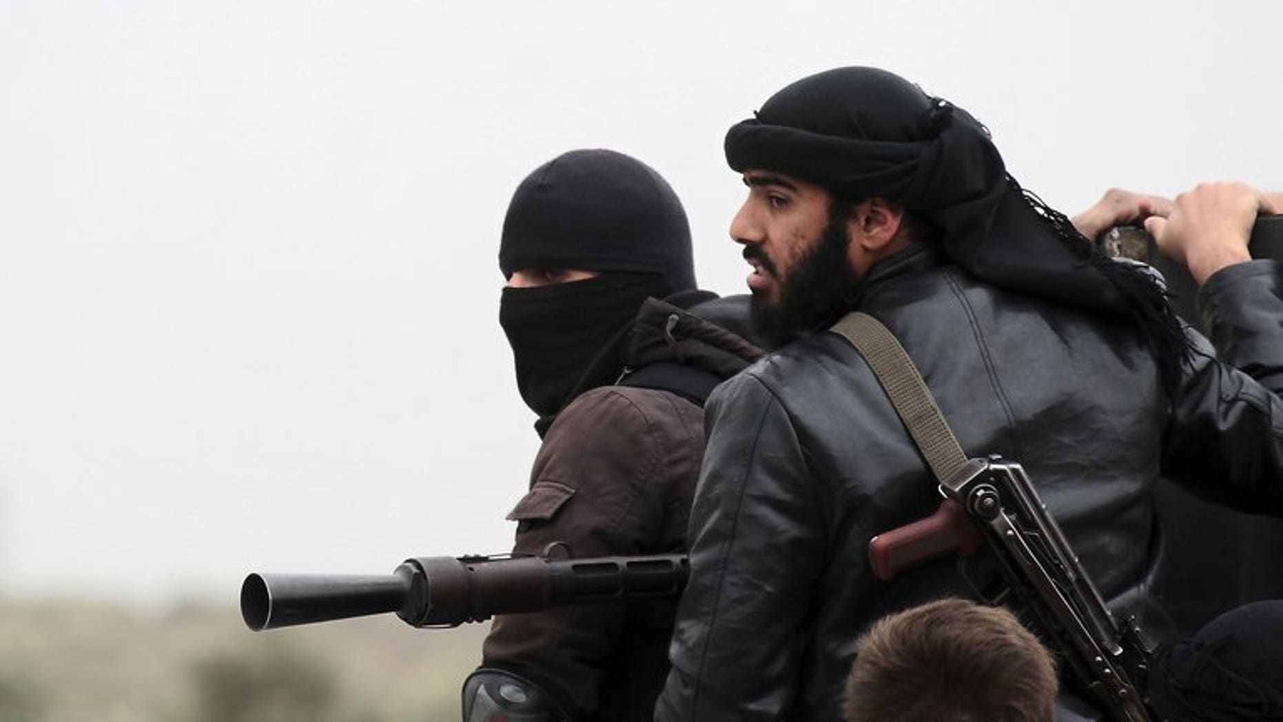 Fighters with the Al-Qaeda-linked Al-Nusra Front in the Syrian village of Aziza, on April 4, 2013. A military tribunal in Jordan has jailed six Muslim extremists for trying to join the Al-Nusra Front to fight against Syrian President Bashar al-Assad's forces.
