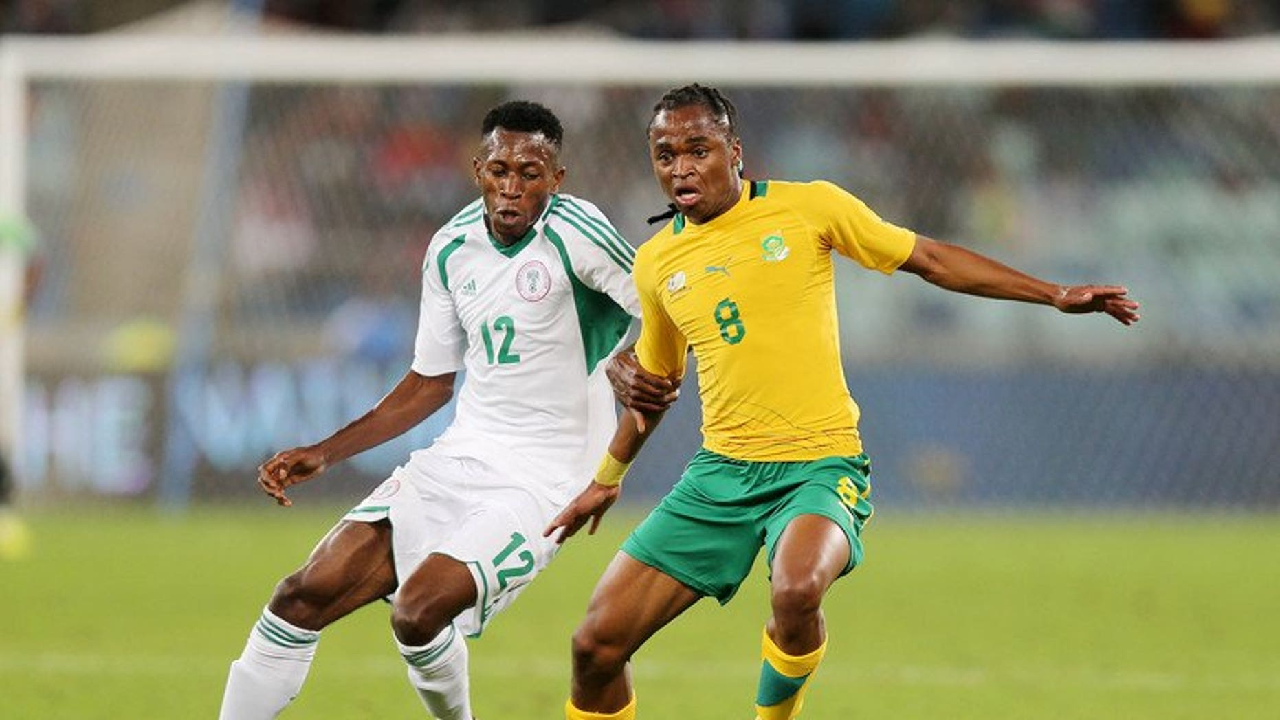 Nigeria's Namdi Ouduamadi challenges Siphiwe Tsabalala of South Africa in a friendly in Durban last month. Major rivals South Africa and Nigeria were drawn together on Wednesday in the first round of the 2014 African Nations Championship (CHAN).