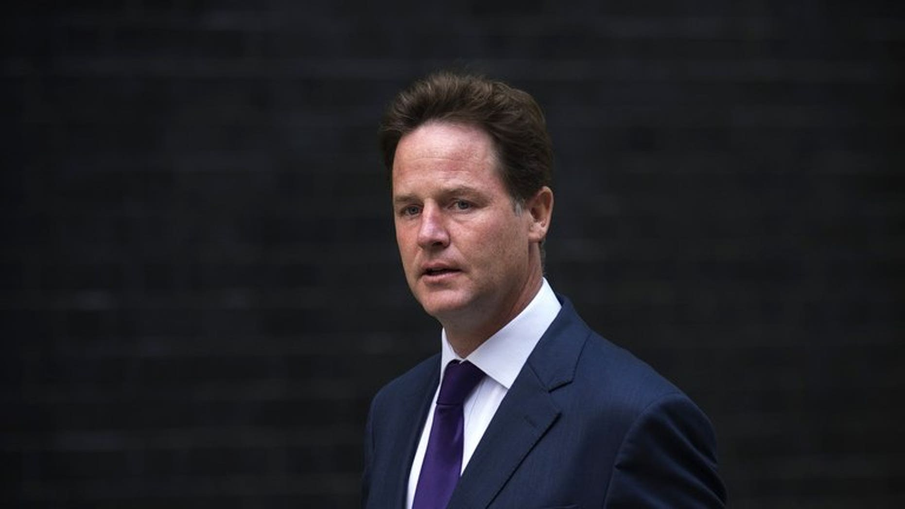 British Deputy Prime Minister Nick Clegg arrives at 10 Downing Street in central London on August 27, 2013.