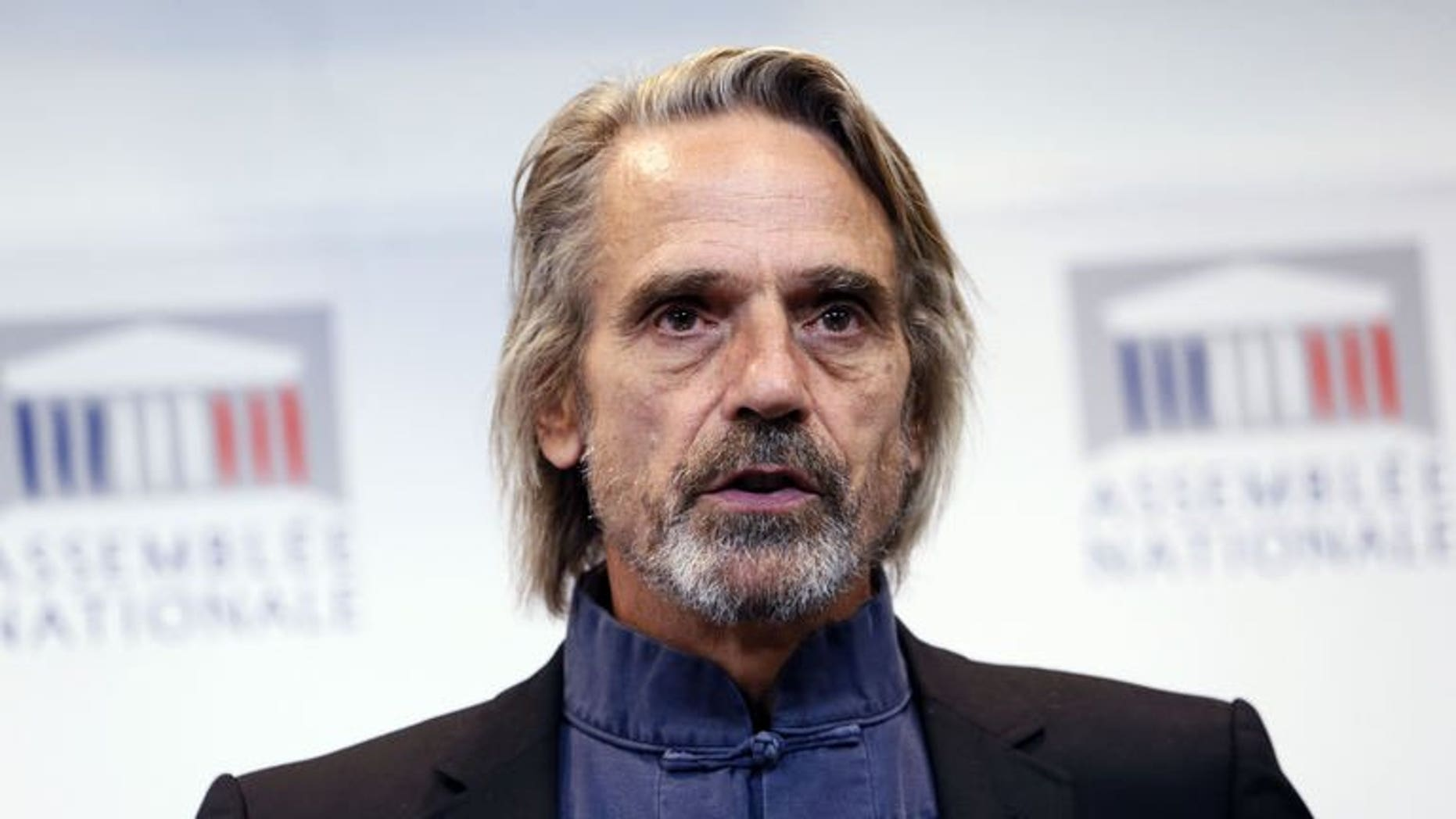 """British actor Jeremy Irons speaks during a press conference to present the new environmental documentary in which he stars """"Trashed"""", at the National Assembly in Paris, on September 18, 2013."""