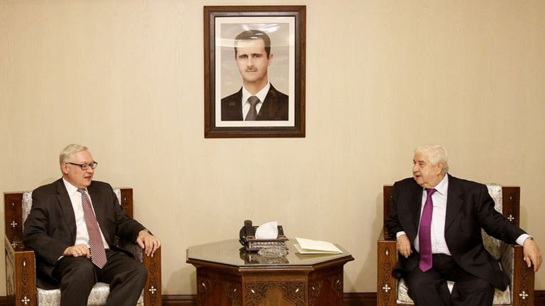 Syrian Foreign Minister Walid Muallem (R) meets with Russian Deputy Foreign Minister Sergei Ryabkov (L) in Damascus on September 17, 2013.