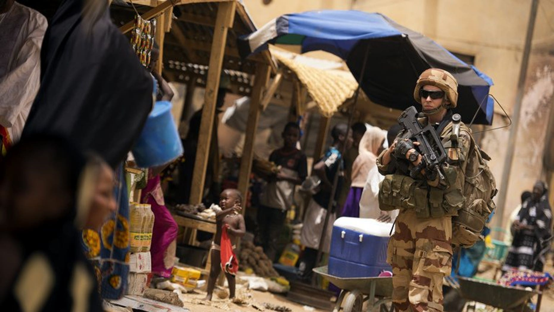 A French soldier patrols in the street in Gao on June 13, 2013.