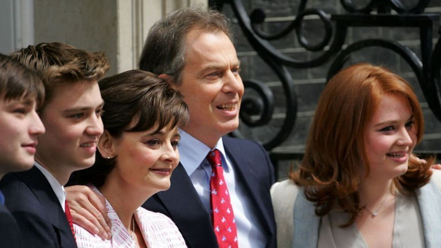 Then British Prime Minister Tony Blair stands with his sons Nicky (L), Euan (2nd L), wife Cherie and daughter Kathryn (R) at 10 Downing Street in London on May 6, 2005. Kathryn Blair has been held at gunpoint in an attempted armed robbery in central London.