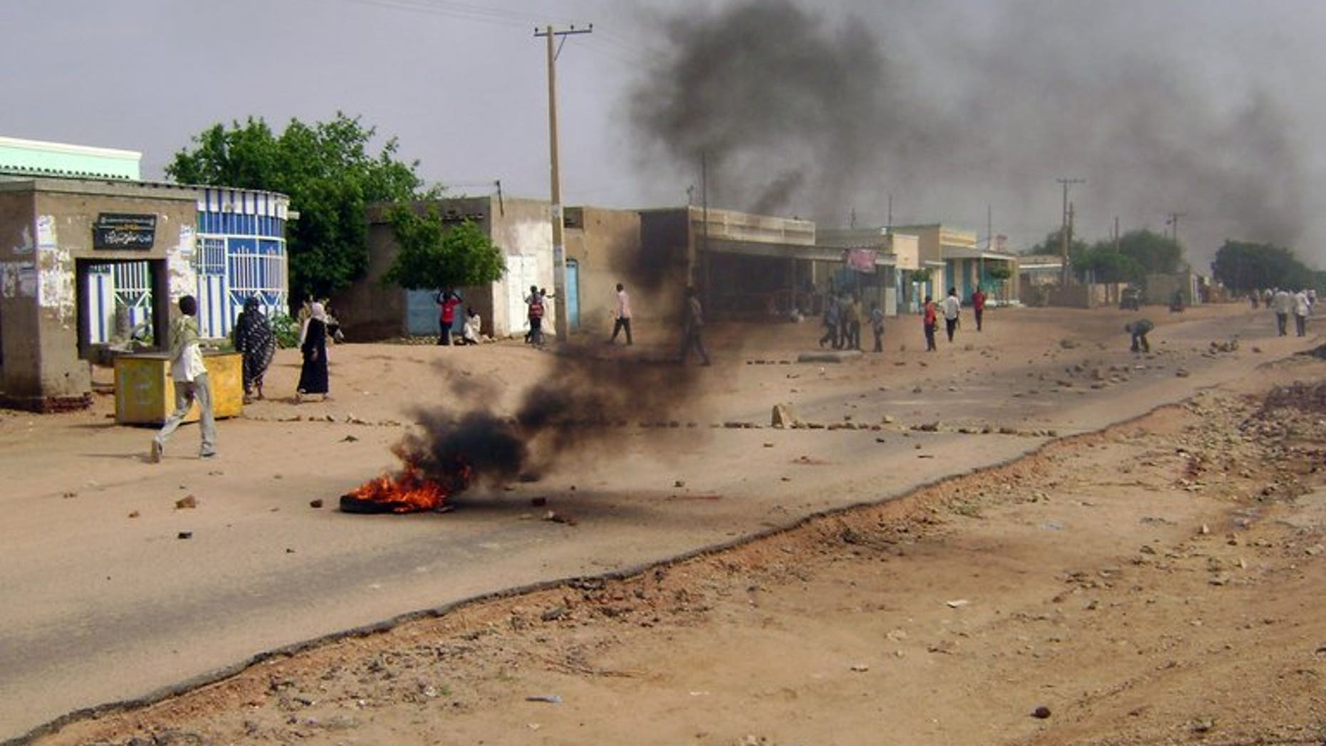 Smoke billows from burning tyres as Sudanese demonstrators protest in Nyala on July 31, 2012. Thousands of angry demonstrators in the South Darfur state capital Nyala clashed with police as they protested the murder of a businessman a day earlier