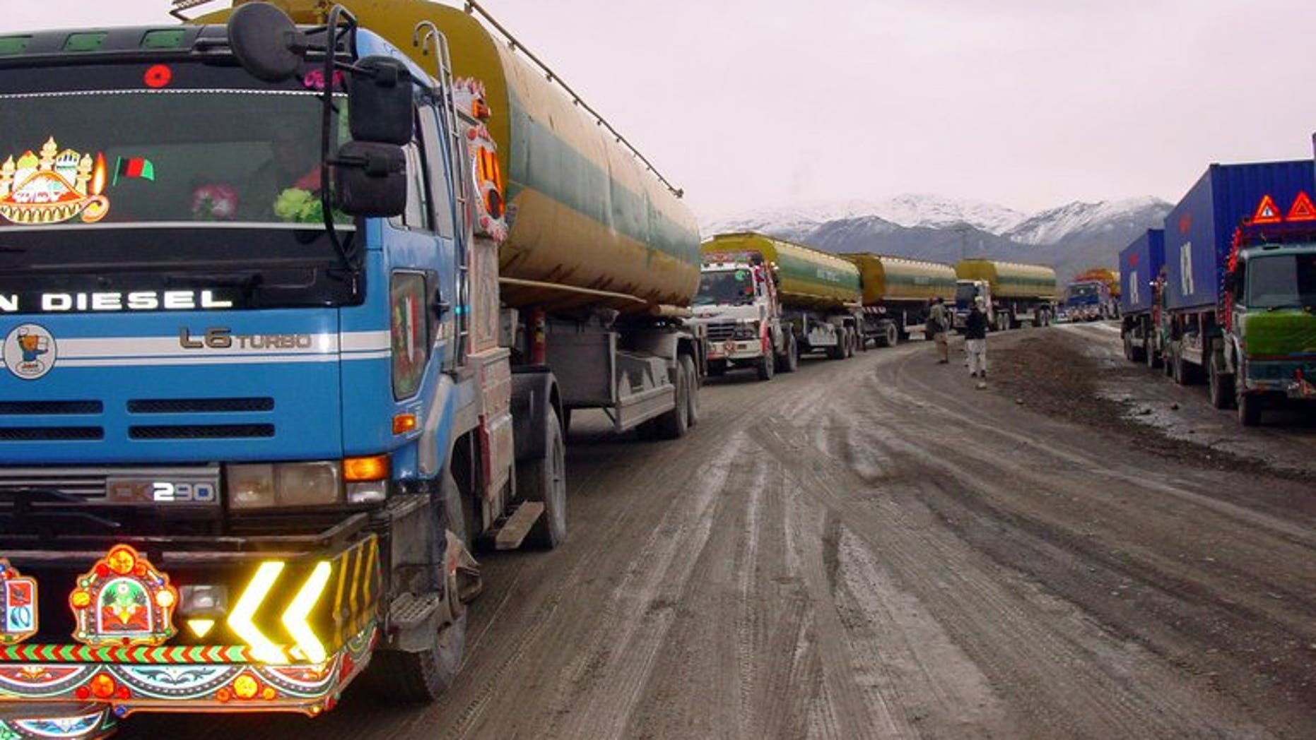 A convoy of NATO supply trucks prepares to cross into Afghanistan at the border town of Chaman on January 14, 2009. Pakistani security officials said Thursday they had arrested 12 members of a gang involved in torching and destroying shipments for NATO troops in Afghanistan.