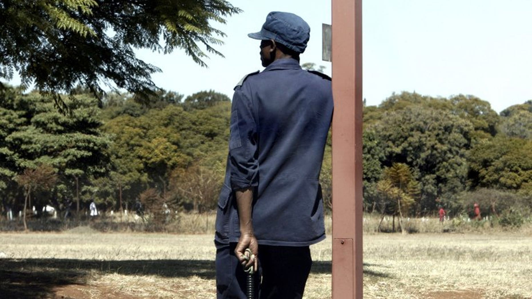 A Zimbabwean police officer stands guard in Harare on June 22, 2008. Zimbabwe's high court ordered the release of 21 opposition activists detained for over two years in connection with the death of a police officer