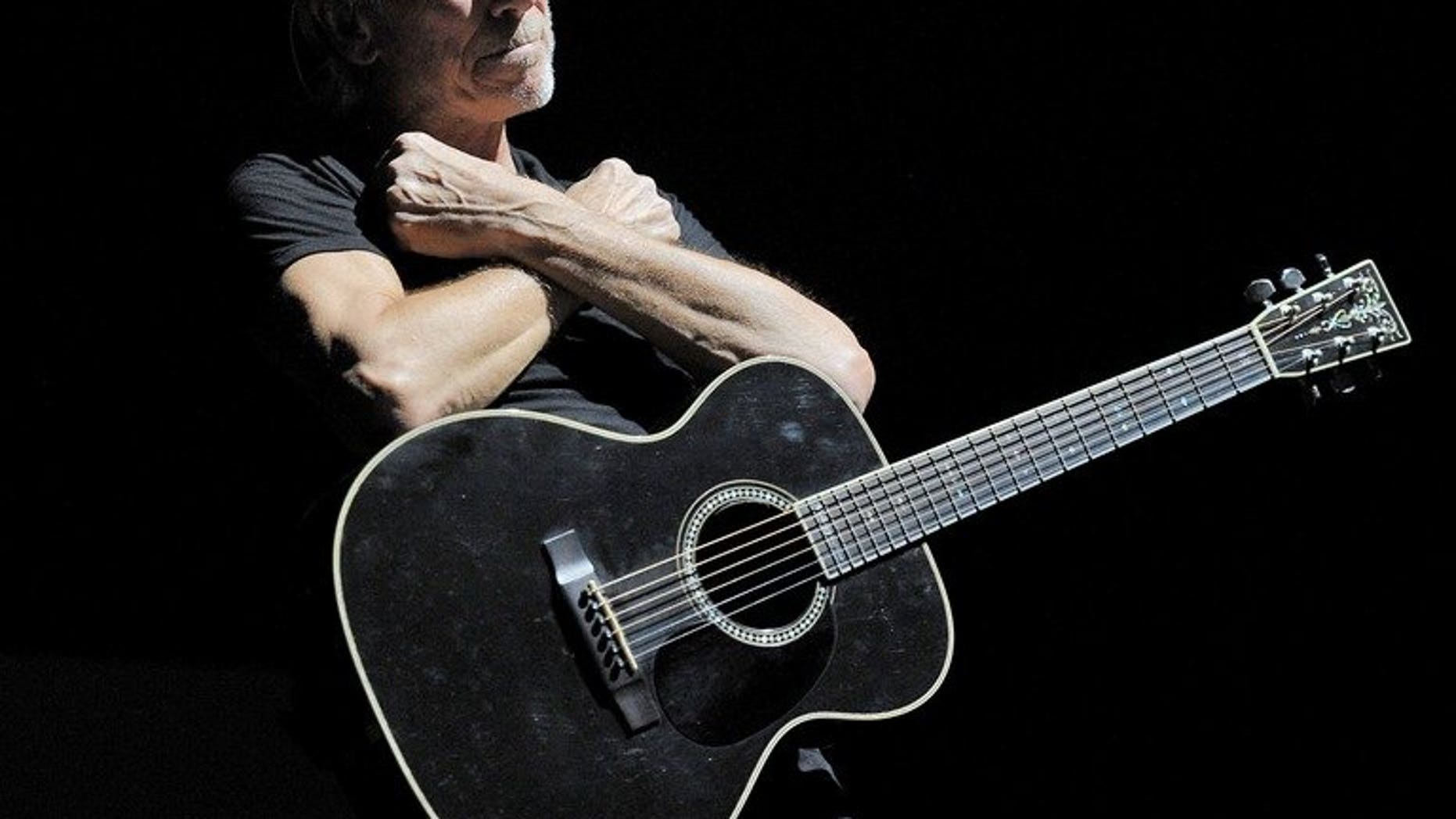British singer Roger Waters performs during his 'The Wall' tour at the Esprit Arena in Duesseldorf, Germany, on September 6, 2013.