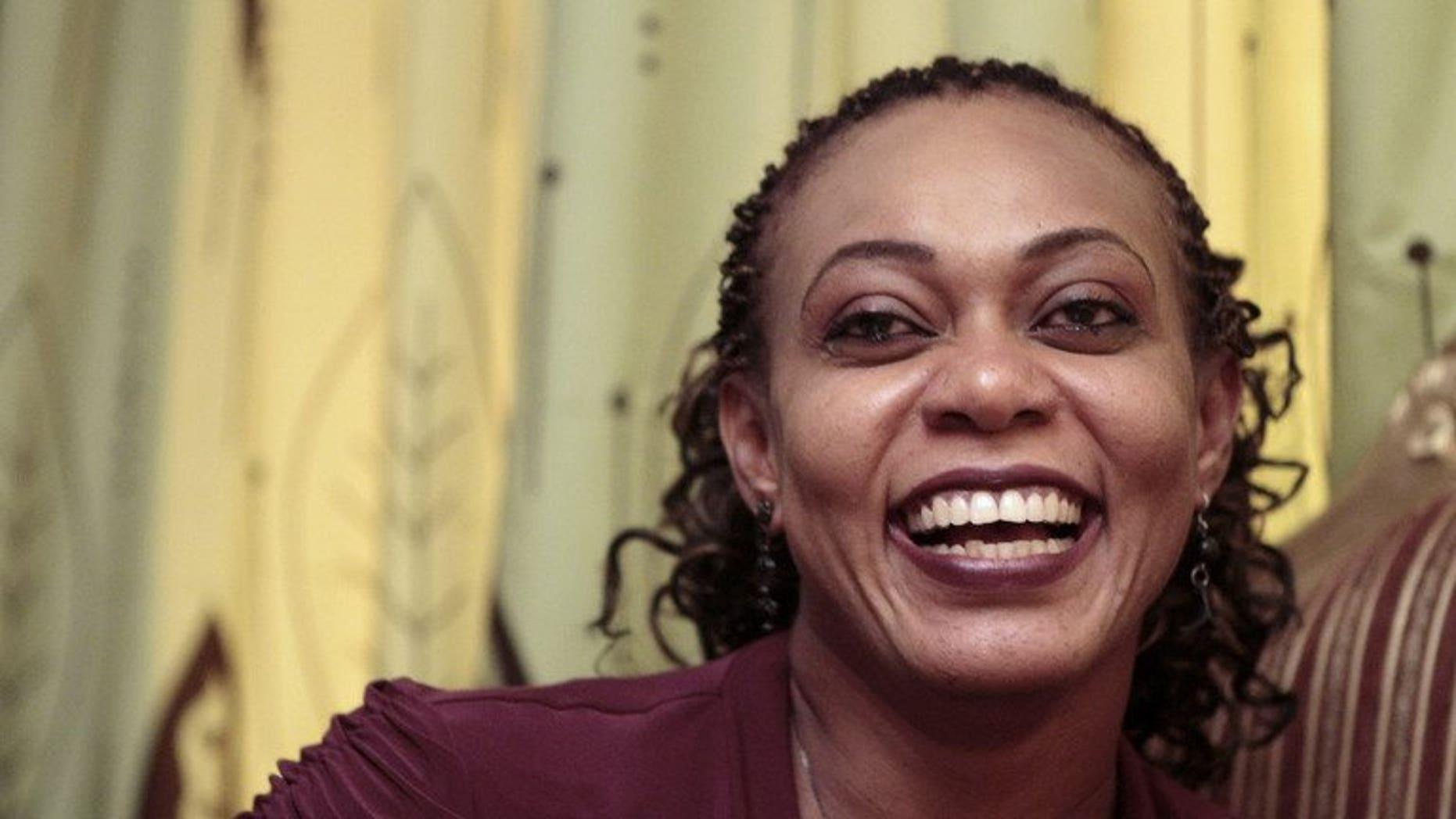Sudanese Amira Osman Hamed speaks with an AFP journalist during an interview in Khartoum on September 8, 2013.