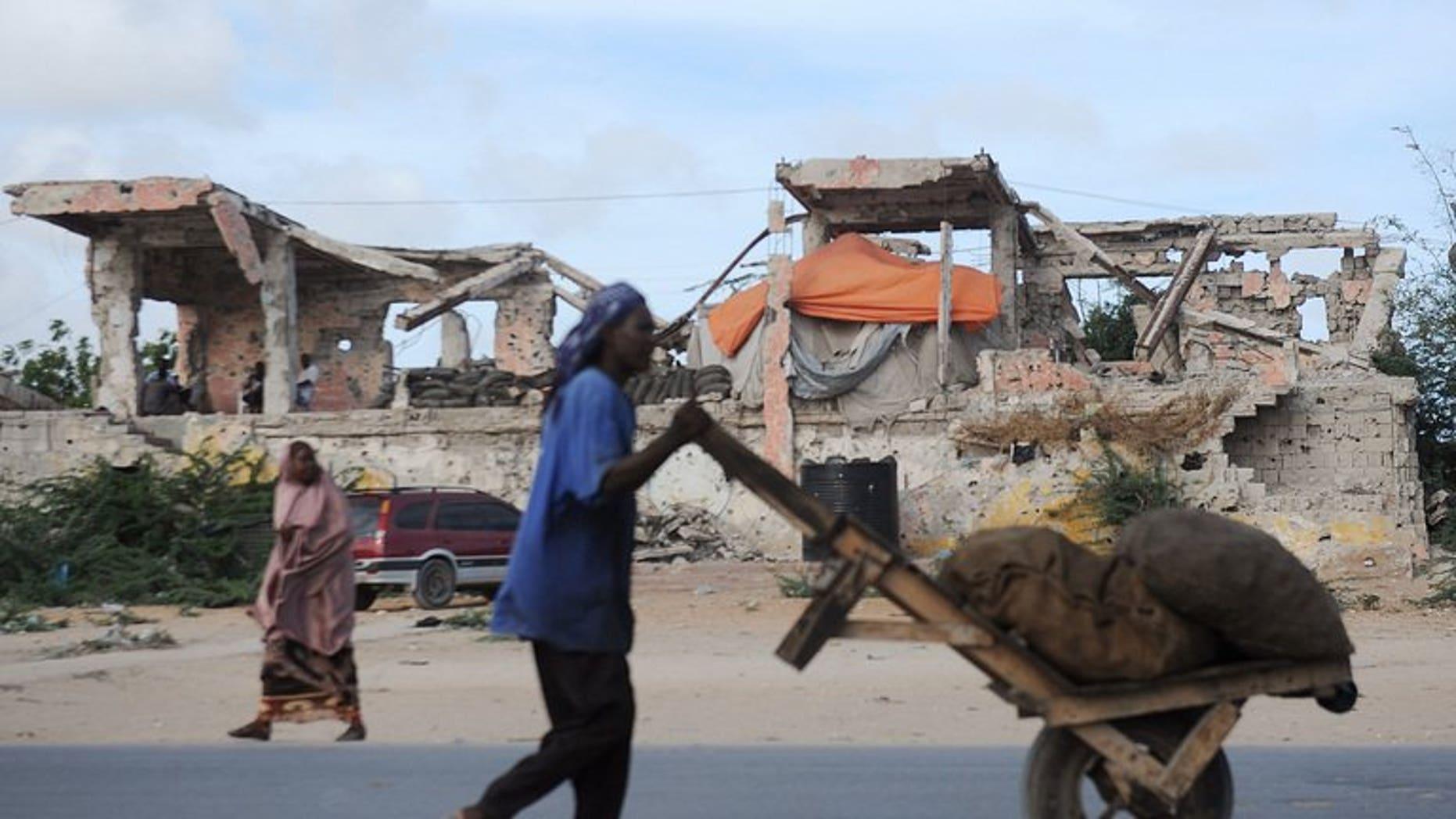 A man carts sacks of charcoal in Mogadishu on April 23, 2013.