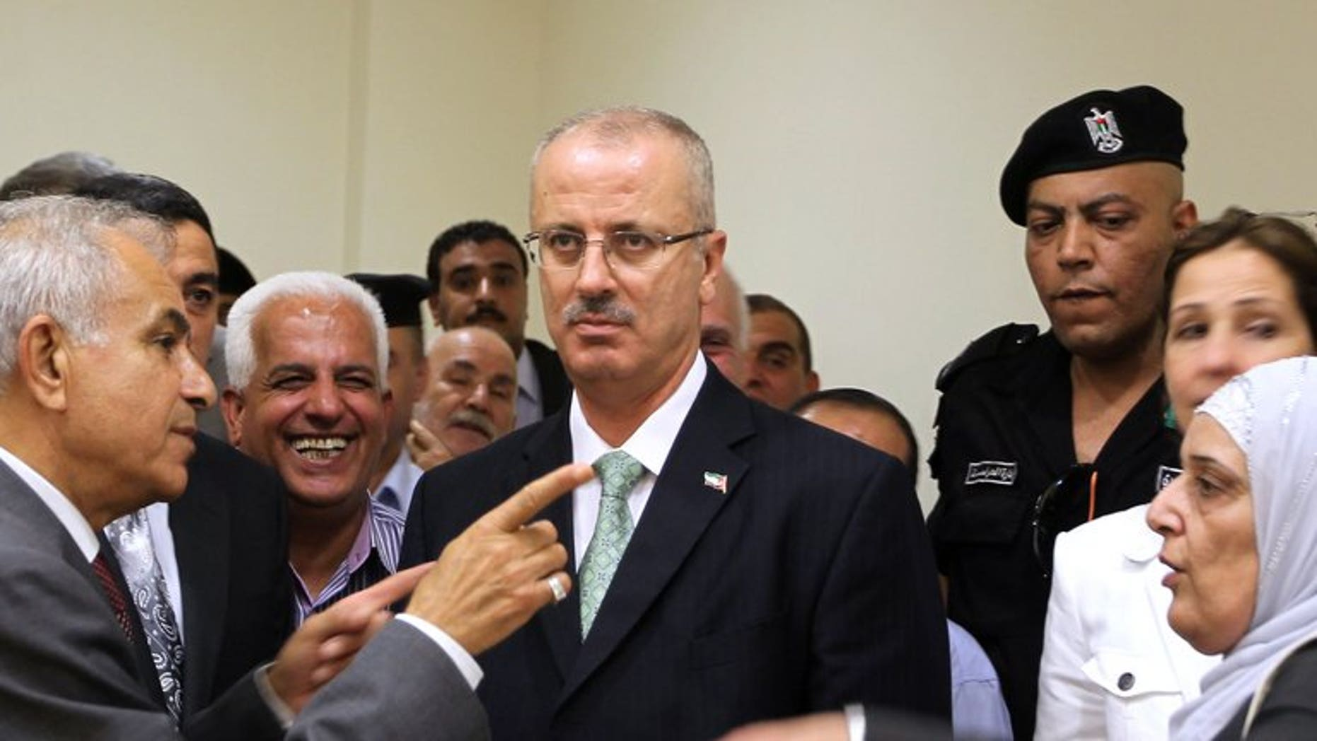 Newly appointed Palestinian prime minister Rami Hamdallah visits the West Bank city of Nablus on June 4, 2013.