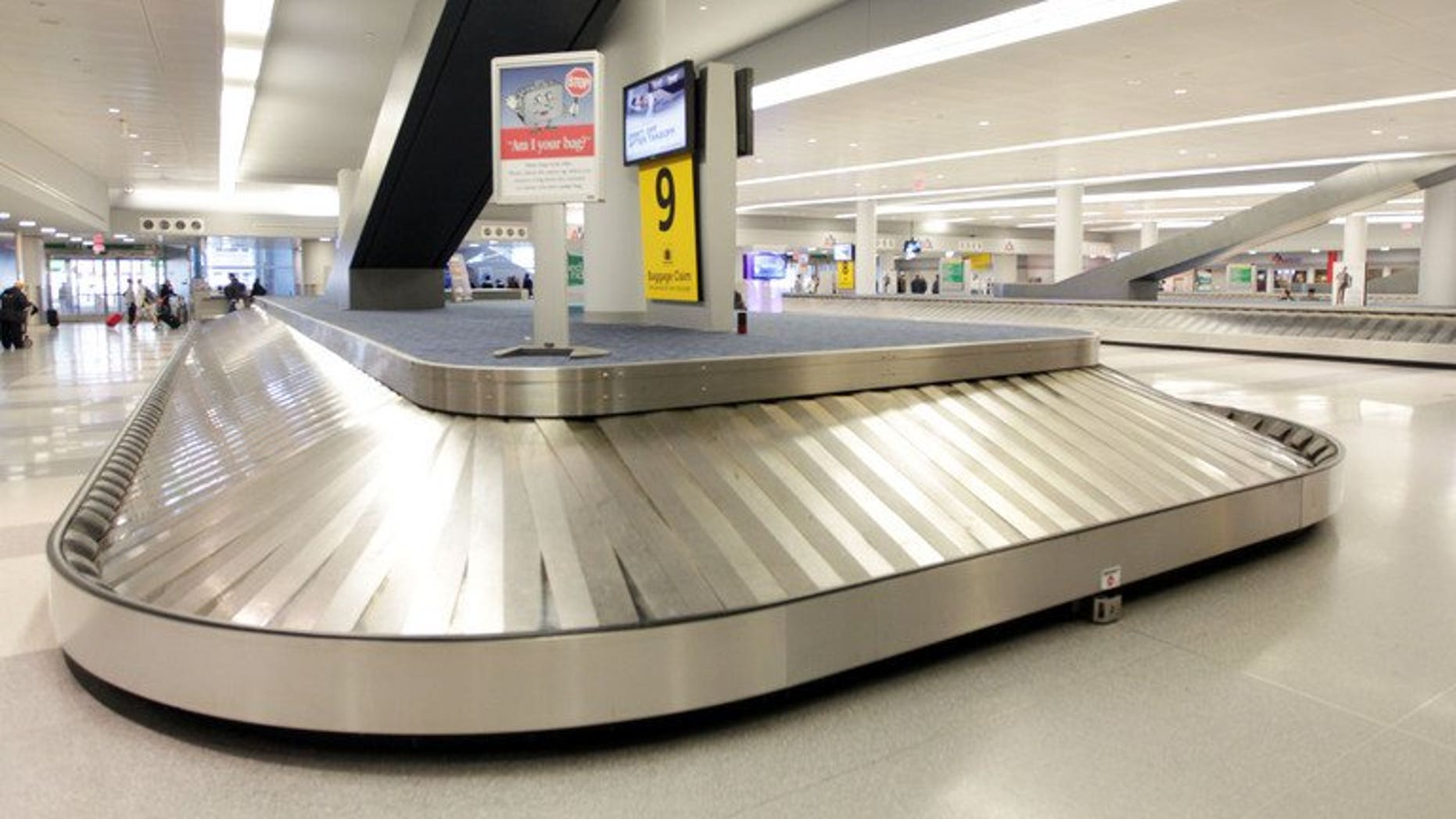 An empty baggage return area at New York's John F. Kennedy International Airport on October 31, 2012. A five-month-old baby died in a Spanish airport on Thursday after being placed on a luggage belt that then started moving without its parents noticing, officials said.