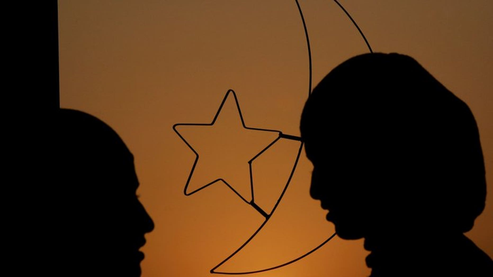 "Women stand in front of a window decoration of Islam's crescent moon and a five point star. Tunisian women have travelled to Syria to wage ""sex jihad"" by comforting Islamist fighters battling the regime there, Interior Minister Lotfi ben Jeddou has told MPs."