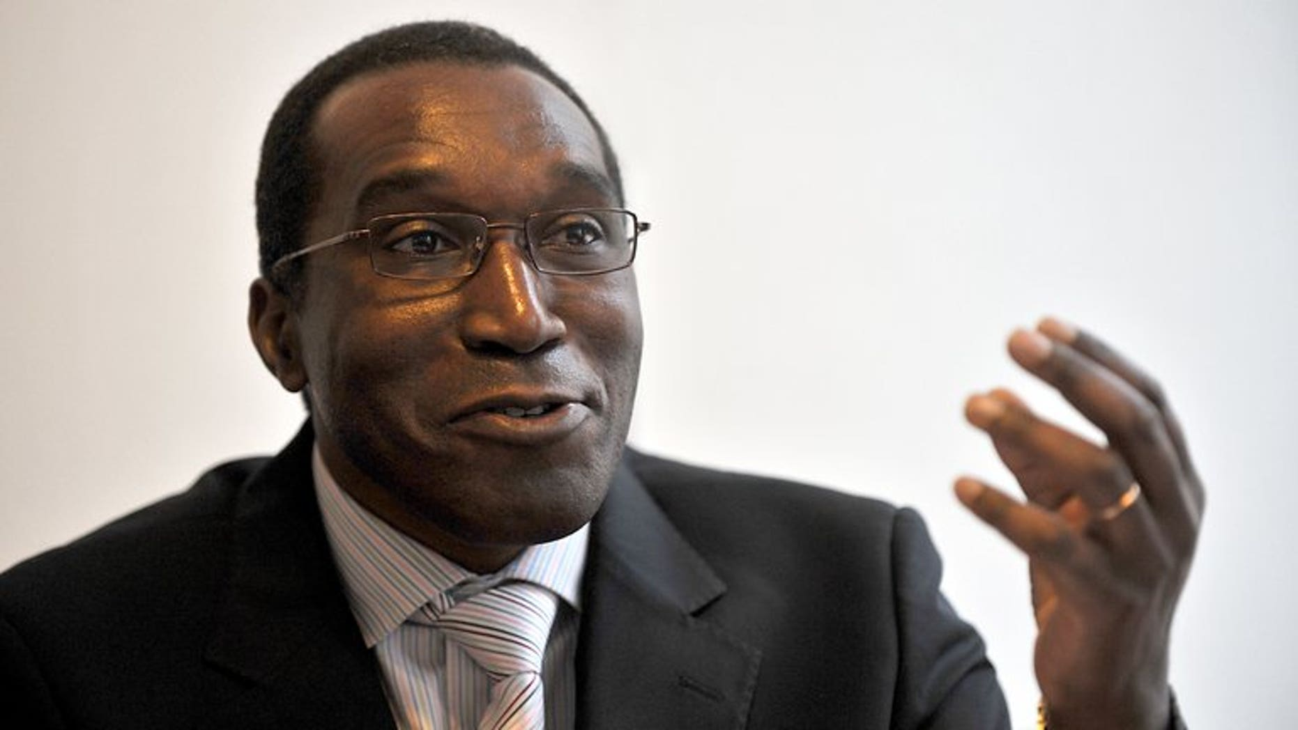 """Rwandan doctor Eugene Rwamucyo gives an interview in Lille on October 24, 2009. French judges have charged Rwamucyo for planning to """"commit the crime of genocide"""" in 1994, a judicial source said, after Kigali issued an international warrant against him."""