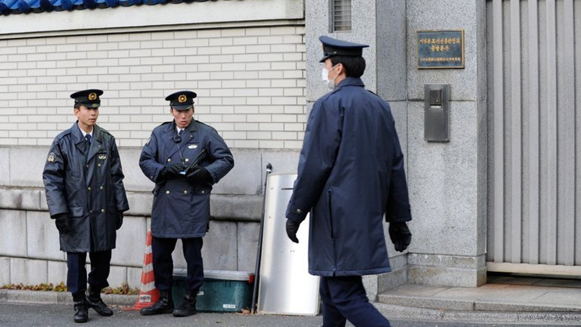 File picture shows policemen in Tokyo on December 19, 2011. Seven people who allegedly dissolved the body of a gigolo-club owner using chemicals found in drain cleaner have been arrested by Japanese police, officials and media reports said Friday.