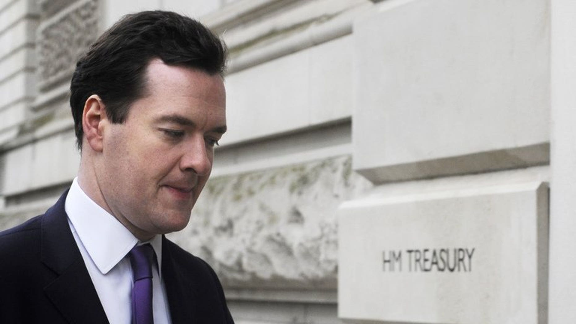 Chancellor of the Exchequer Geroge Osborne walks into the Treasury in London on January 25, 2012. State borrowing sank last month on lower public spending and high tax receipts, official data shows, boosting the government's attempt to slash Britain's huge deficit.