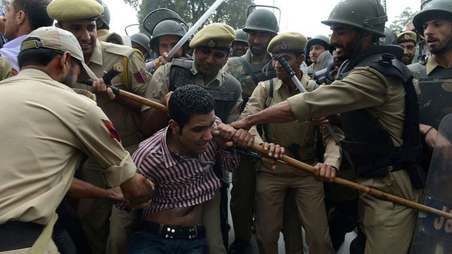 File picture shows Indian police detaining an activist of Kashmir's main opposition Peoples Democratic Party (PDP) during a protest against the killing of a youth in Shopian, near Srinagar on September 13, 2013.