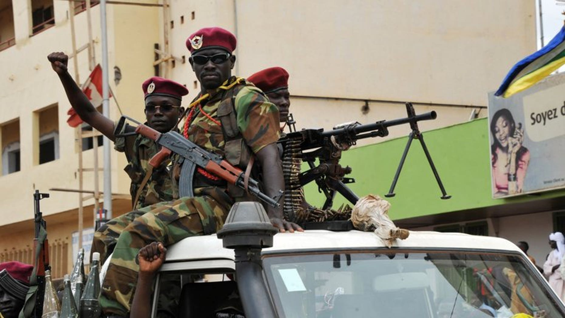 """Seleka rebels patrol on a pickup truck in Bangui on March 30, 2013. The African Union on Friday urged the international community to do more in the poor and strife-torn Central African Republic, describing the situation there as """"dire""""."""