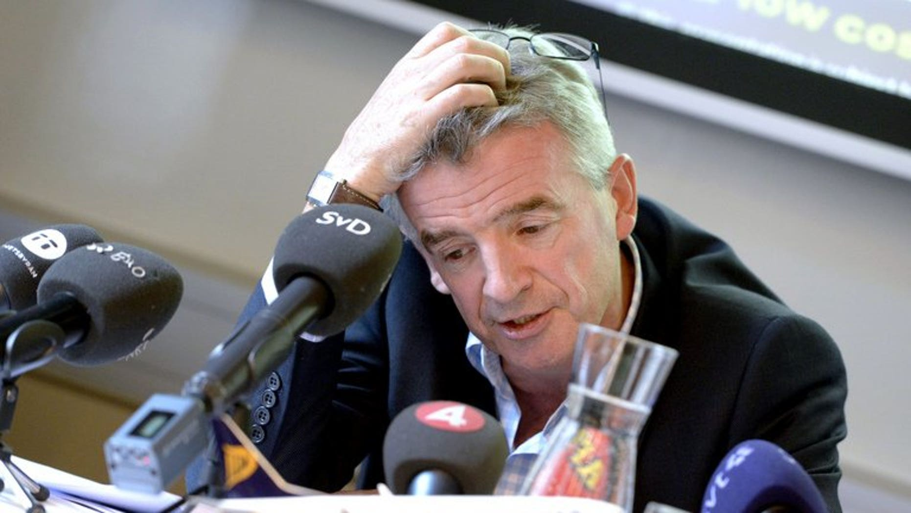 Ryanair chief executive Michael O'Leary is pictured in Stockholm, Sweden on August 29, 2013. Ryanair has apologised to a distraught father who was charged 188 euro (??158) by the budget airline to change his flight from Ireland to England when his wife and three children were killed in a fire.