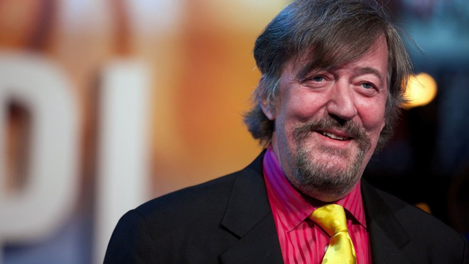 Stephen Fry seen in central London on December 3, 2012. One of the joys of having six million followers on Twitter is never having to talk to journalists, Fry said in a foul-mouthed rant against a hack who questioned whether he wrote his own Tweets.