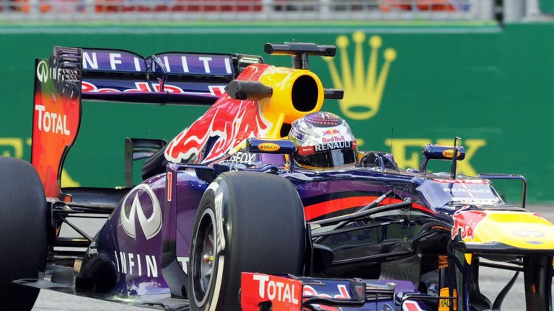 Red Bull driver Sebastian Vettel of Germany speeds around a corner during the first practice session of the Formula One Singapore Grand Prix on September 20, 2013. Vettel set a scorching pace as he dominated free practice at the Singapore Grand Prix in ominous style.