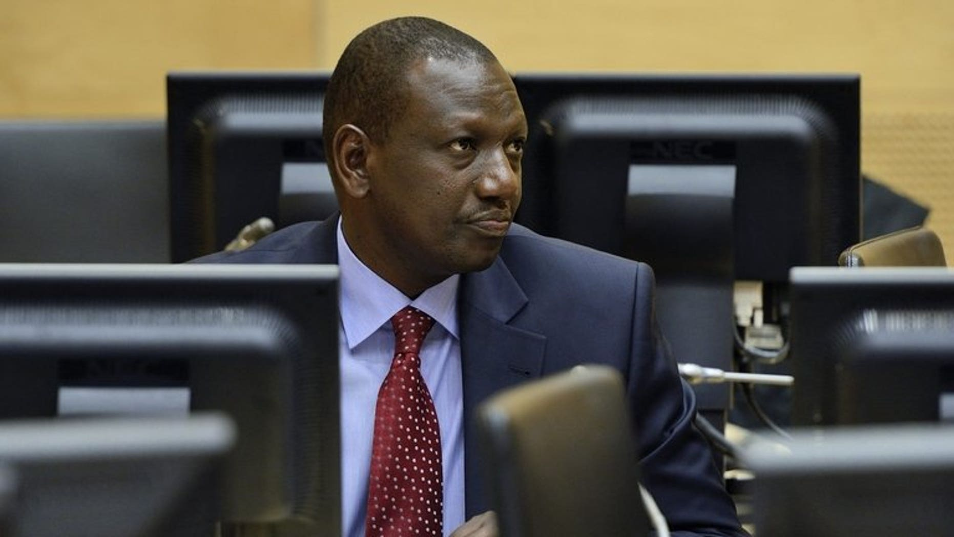 Former Kenyan vice-President William Ruto looks on during a hearing in the International Criminal Court in the Hague, Netherlands, on May 14, 2013.