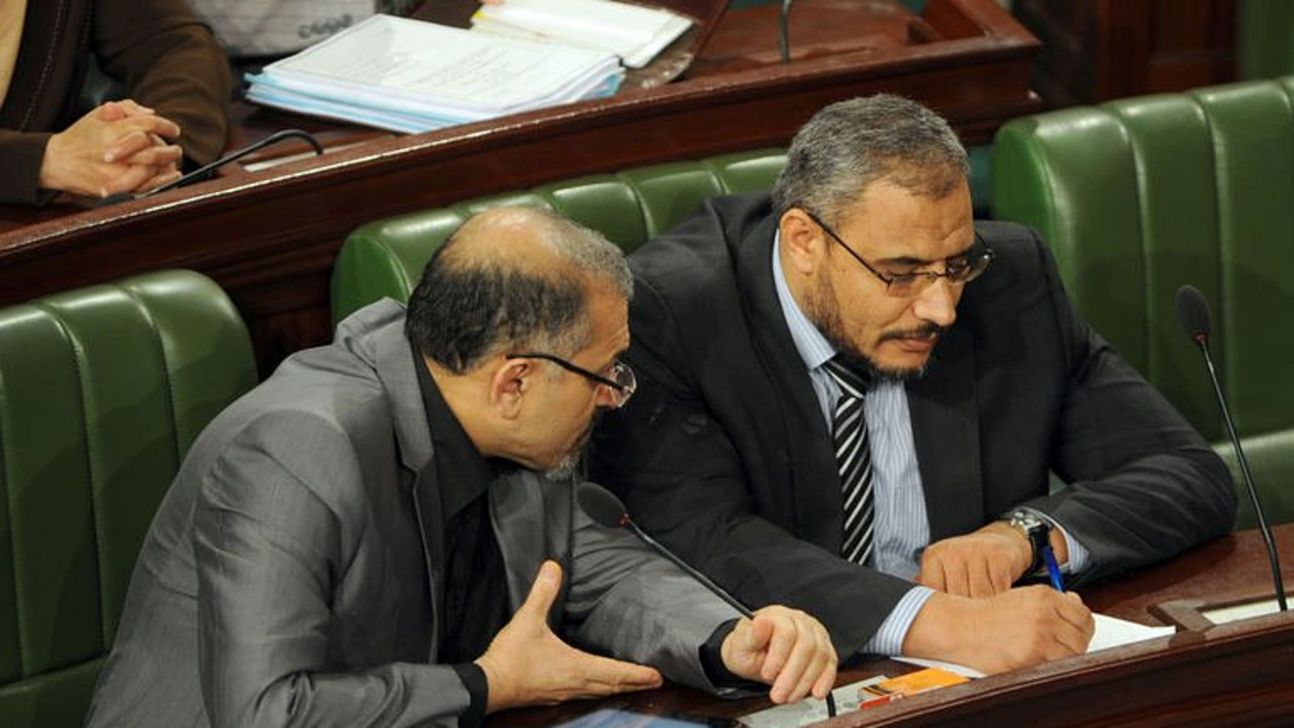 Tunisia's Islamist Prime Minister Ali Larayedh (L) chats with leader of Ennahda's Parliamentary group, Sahbi Atig as they attend a constituent assembly meeting on September 19, 2013.