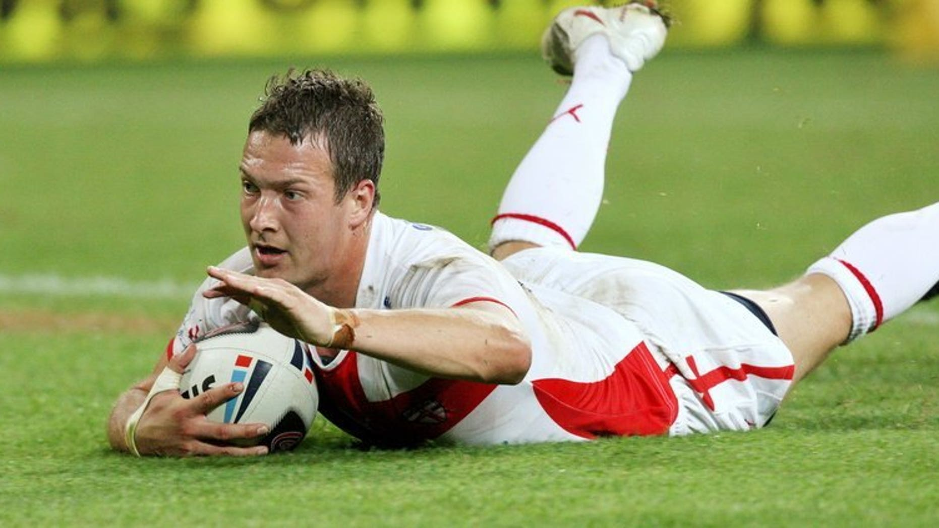 England's Danny McGuire, in action on November 15, 2008, scored a late drop-goal to put defending Super League champions Leeds into the play-off semi-finals as they sealed an 11-10 win over familiar foes St Helens at Headingley
