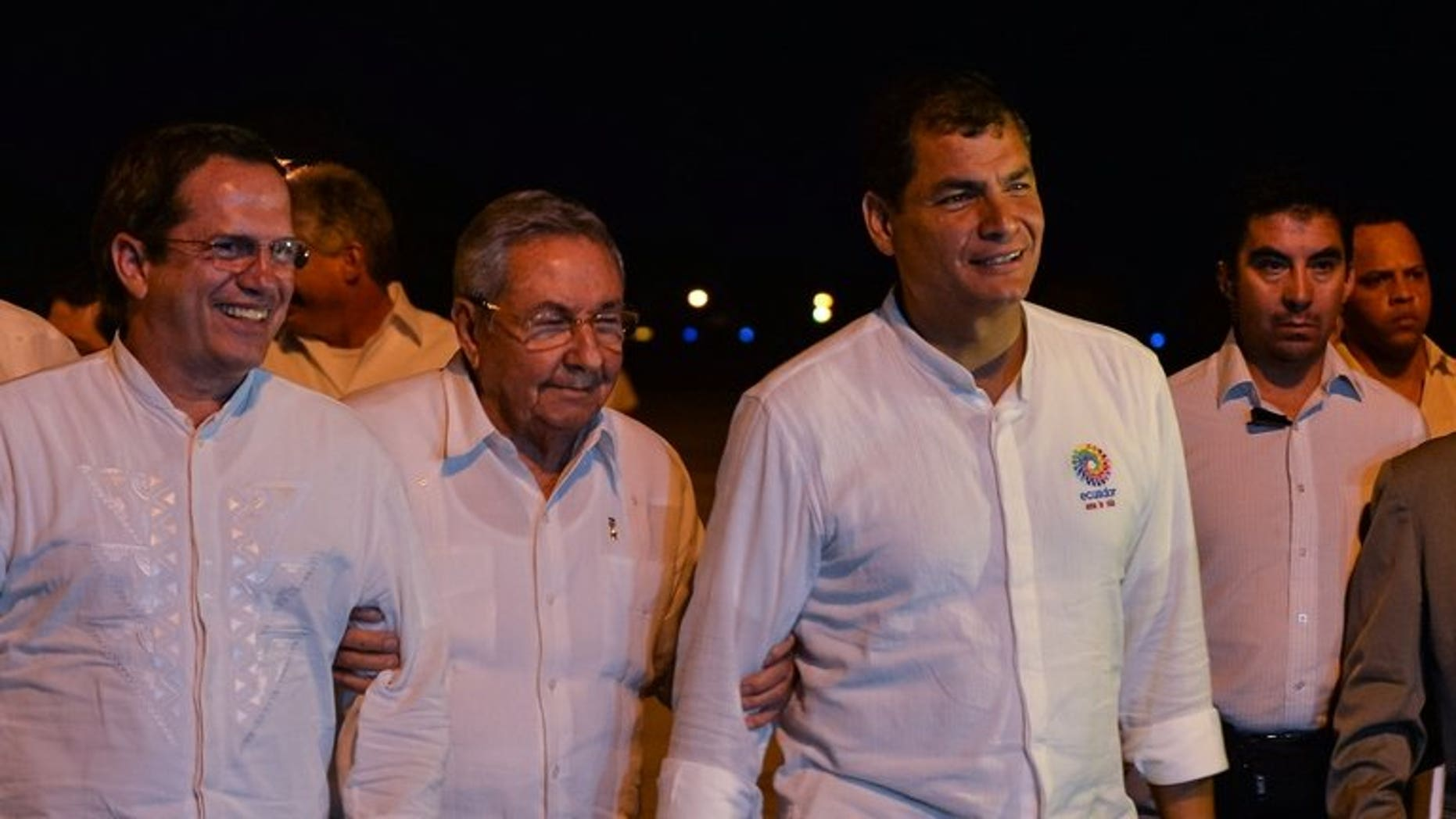 Cuban President Raul Castro (center) is flanked by Ecuadorian counterpart Rafael Correa (right) and Foreign Minister Ricardo Patino at the Jose Marti Airport in Havana, on September 21, 2013. Correa is in Havana to meet Cuban revolutionary leader Fidel Castro and his younger brother Raul Castro.