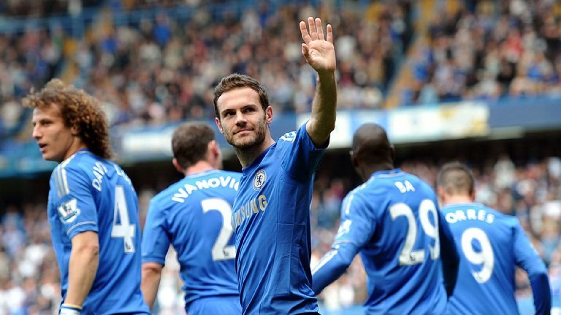 Chelsea's Spanish midfielder Juan Mata celebrates after scoring the opening goal against Everton at Stamford Bridge in London on May 19, 2013. Mata's status at Chelsea appears increasingly fragile after manager Jose Mourinho declared that Brazilian Oscar was now his number one playmaker.