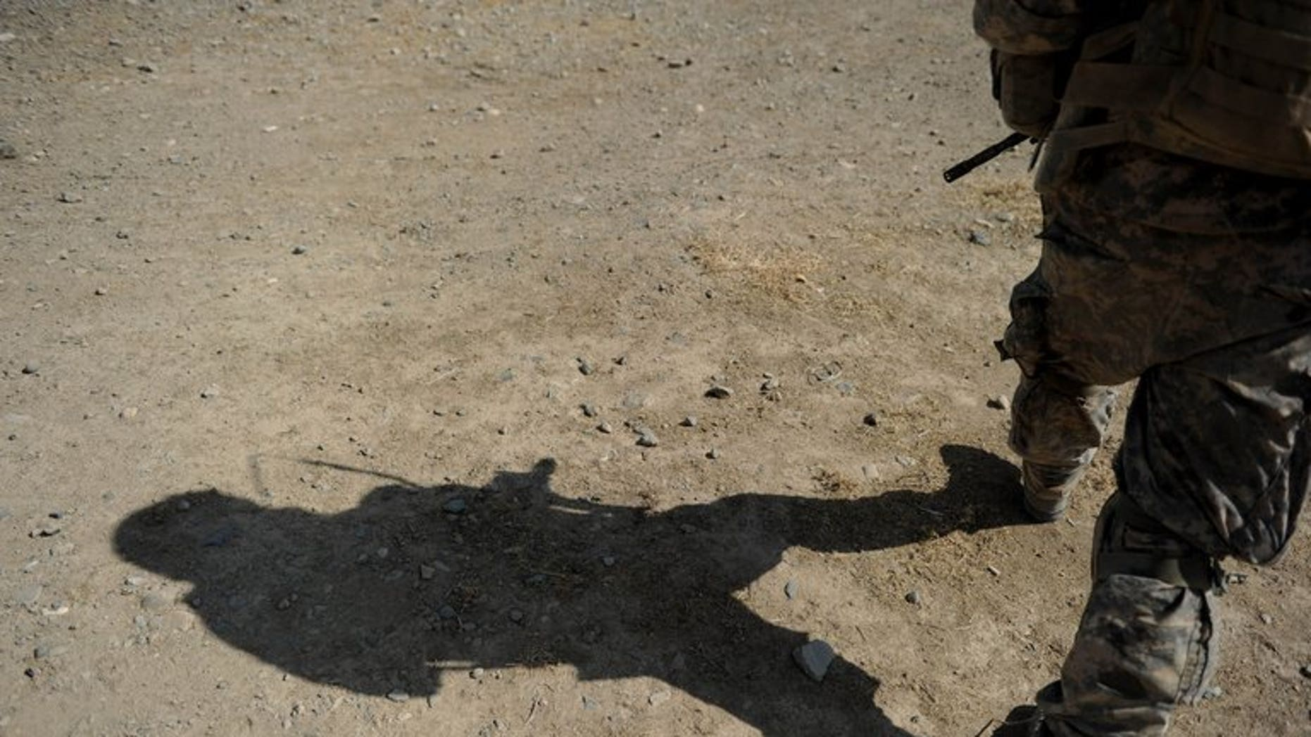 A US Soldier serving with the NATO-led mission in Afghanistan in Kandahar province on August 6, 2010. A man wearing Afghan security forces uniform shot dead three NATO-led soldiers on Saturday in the eastern part of the country, the coalition said.