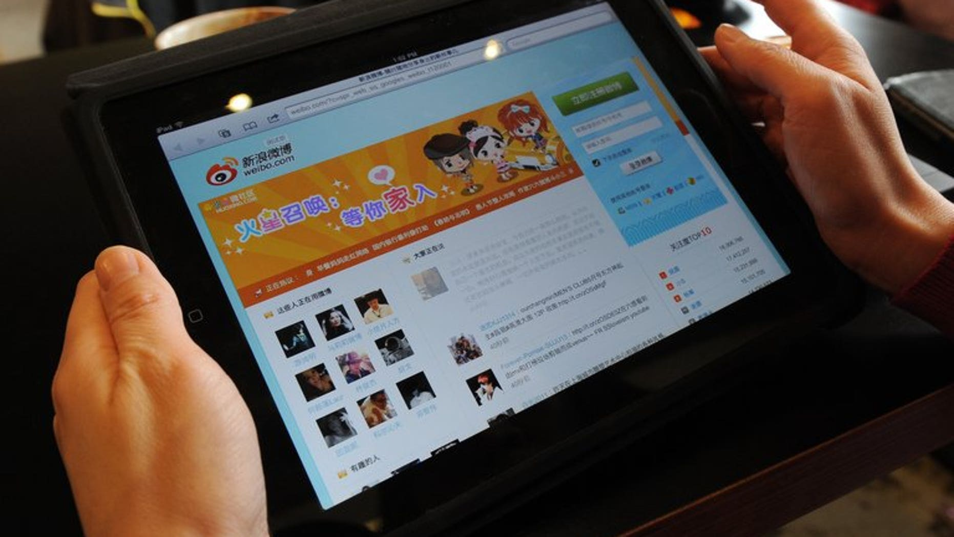 A woman views the Chinese social media website Weibo at a cafe in Beijing on April 2, 2012.