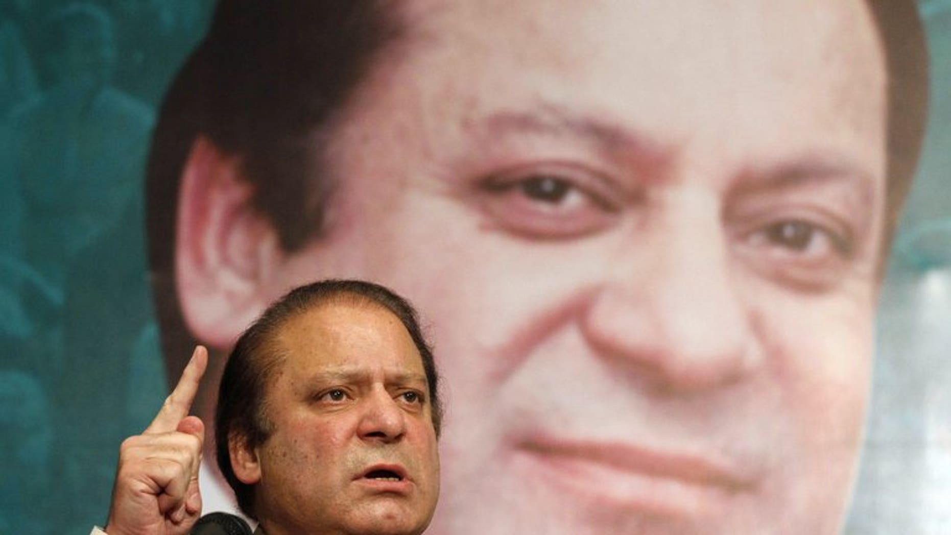 Pakistan's then incoming Prime Minister Nawaz Sharif addresses his party's newly elected MPs in Lahore on May 20, 2013.