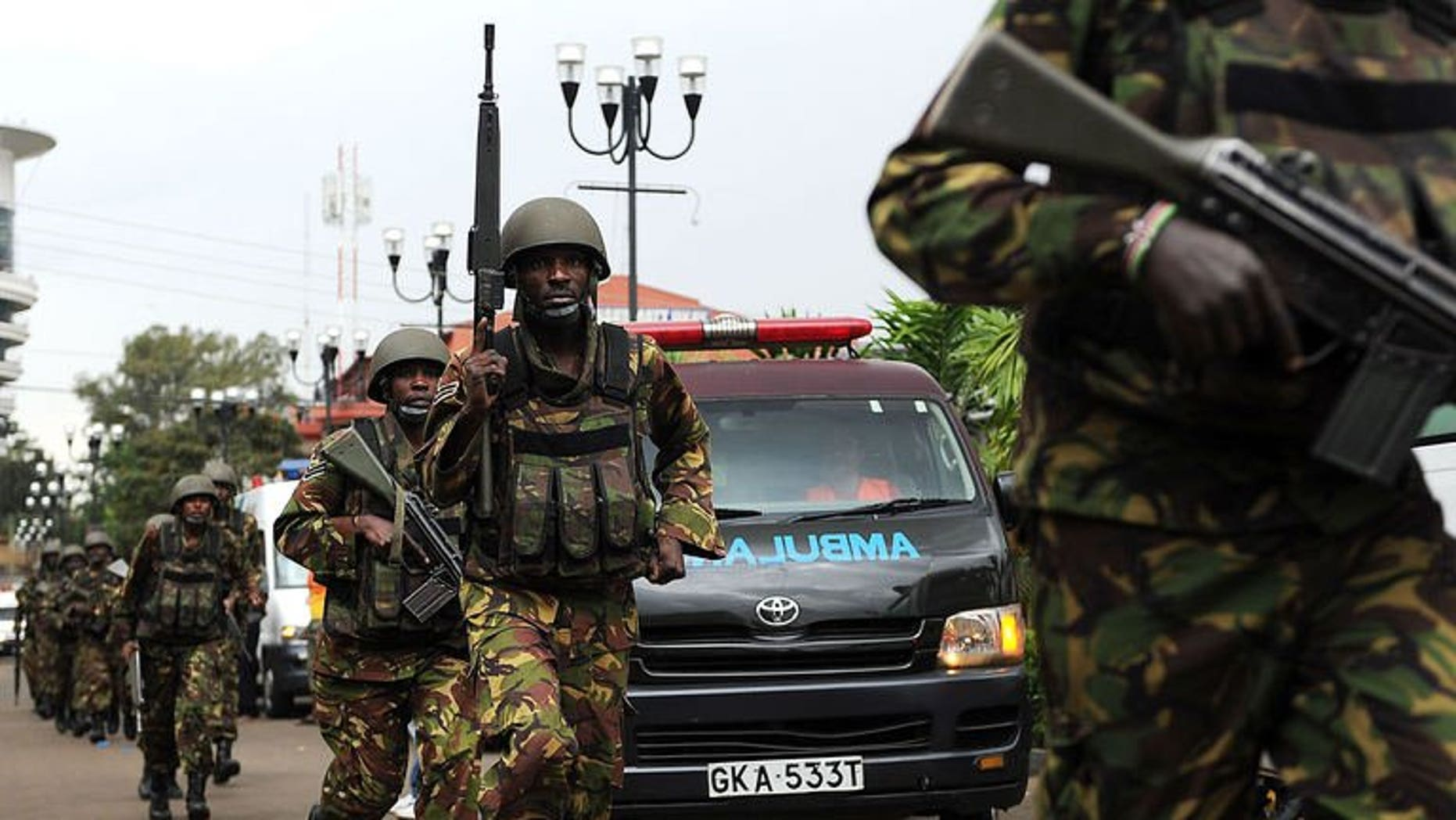 Military personel mobilise on September 21, 2013 outside an upmarket shopping mall in Nairobi.