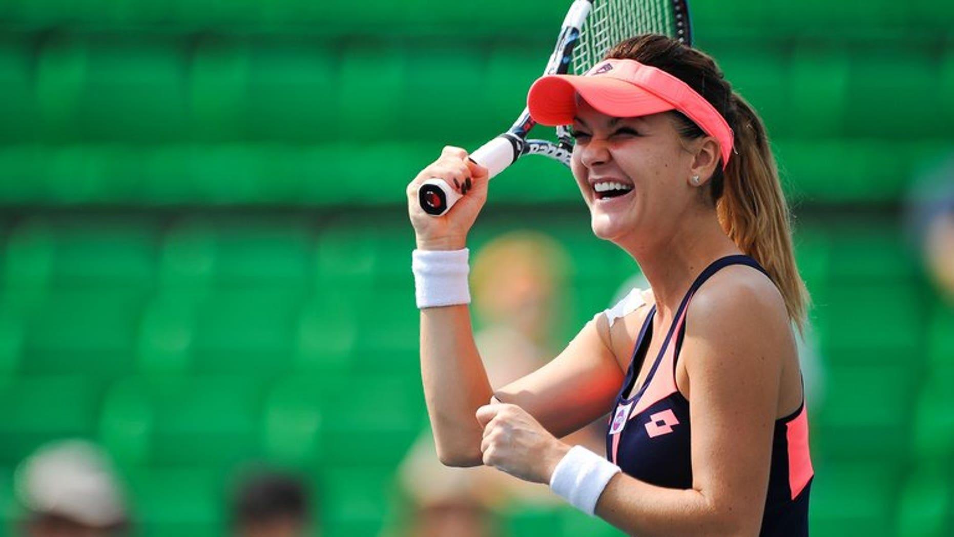 Agnieszka Radwanska of Poland at the 2013 WTA Korea Open tennis tournament in Seoul on September 21, 2013. Radwanska rallied from a set down to win the Korea Open at her first attempt on Sunday, edging out Russian Anastasia Pavlyuchenkova 6-7 (6/8), 6-3, 6-4.