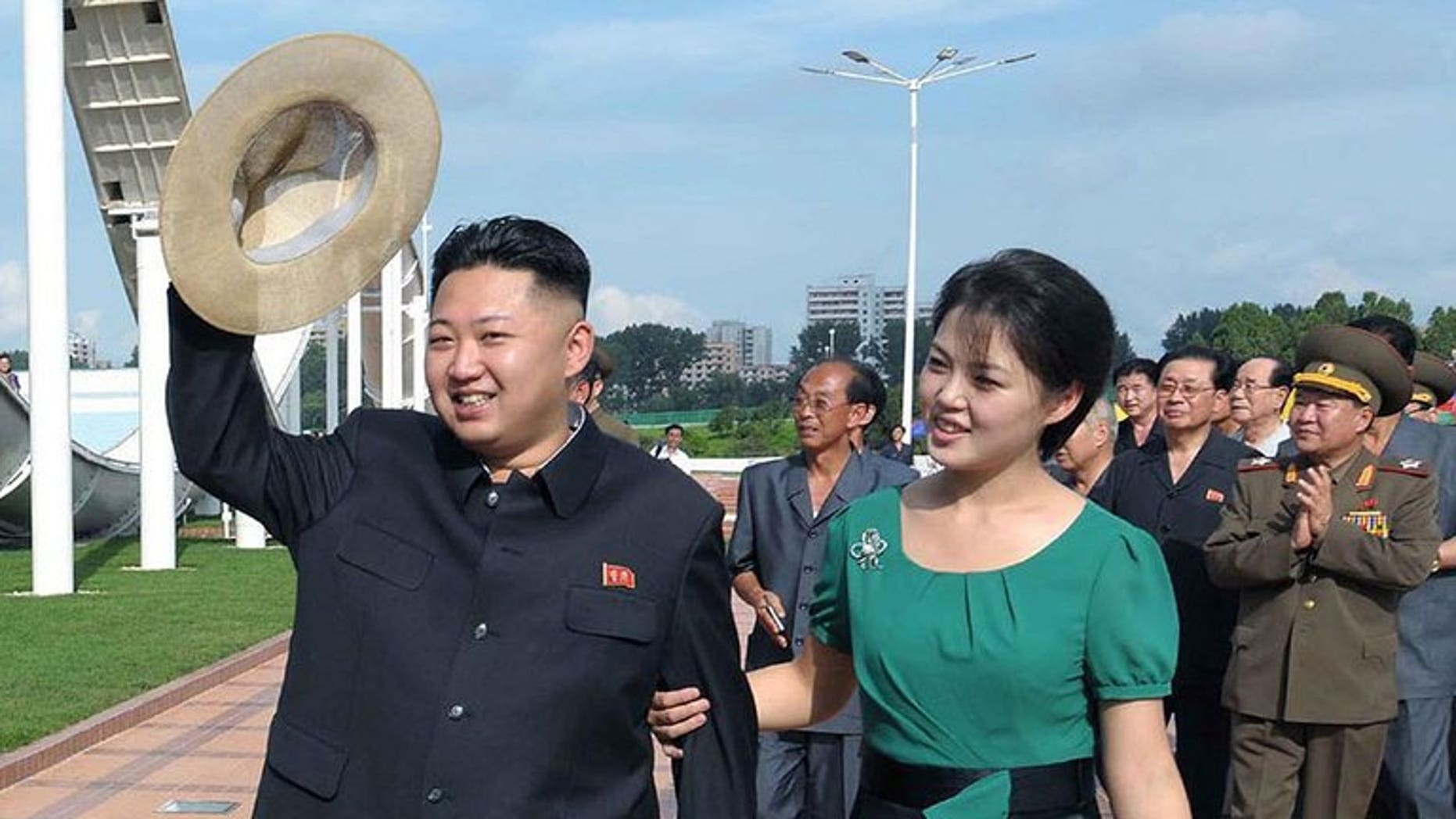 This picture released by North Korea's official Korean Central News Agency (KCNA) via the Korea News Service (KNS) shows North Korean leader Kim Jong-Un and his wife Ri Sol-Ju visiting the Rungna People's Pleasure Ground in Pyongyang, on July 26, 2012. North Korea has angrily denied reports that it had executed several state performers to cover up the past of its first lady.