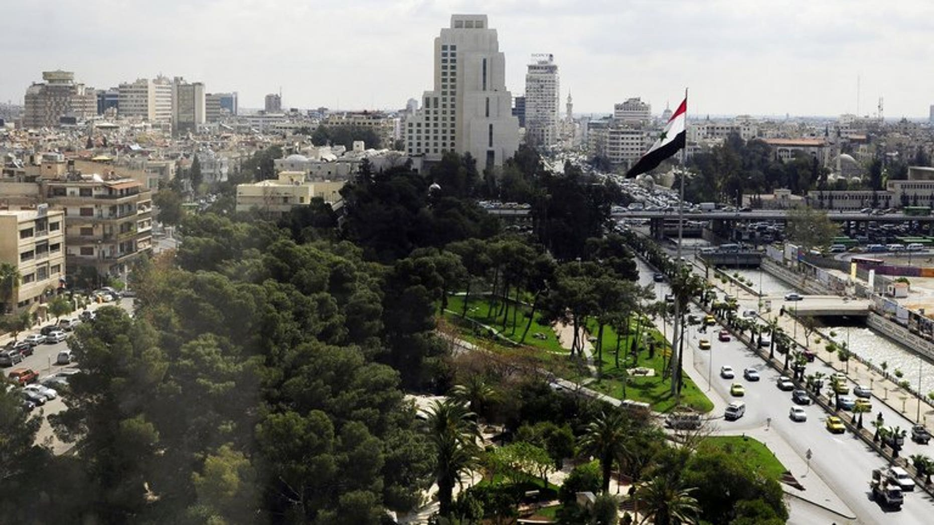 A handout released by the Syrian Arab News Agency (SANA) shows an aerial view of Damascus, on April 6, 2011. A mortar round hit the compound of the Russian embassy in Damascus, according to the Syrian Observatory for Human Rights.