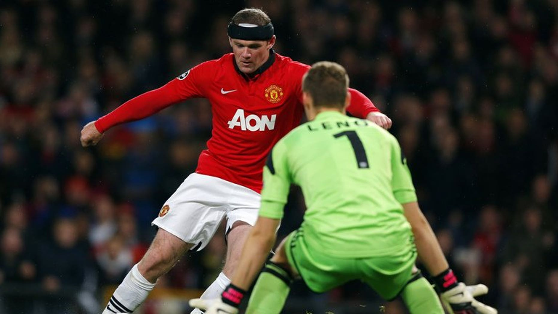 Manchester United's Wayne Rooney (left) and Bayer Leverkusen's Bernd Leno at Old Trafford, September 17, 2013. Rooney was never close to joining Chelsea in the summer because Manchester United would not have sold him, former chief executive David Gill said Sunday.