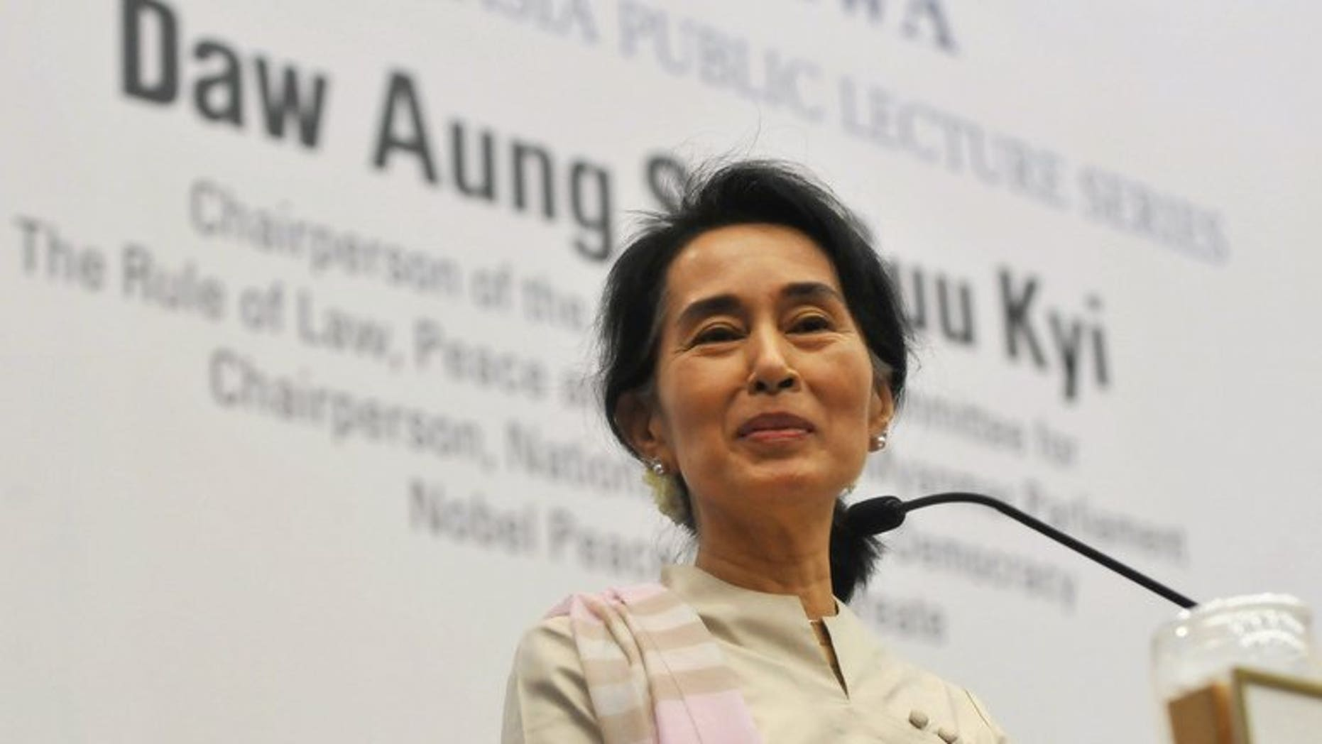 Nobel laureate Aung San Suu Kyi delivers a speech in Singapore, on September 22, 2013. Thousands of Myanmar nationals living in Singapore have given Suu Kyi an emotional welcome as the democracy icon urged them to consider coming home to help rebuild the impoverished nation.