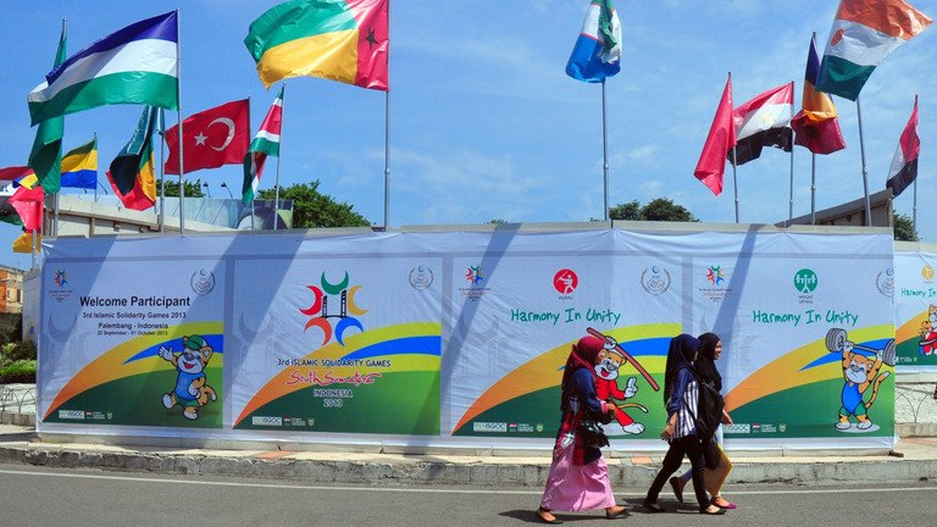 The flags of countries participating in the Islamic Solidarity Games decorate a venue at the Palembang sports complex in Palembang on Indonesia's Sumatra island on September 20, 2013. The games got under way in Indonesia on Sunday despite a chaotic run-up to the event and debates over appropriate outfits for Muslim athletes.