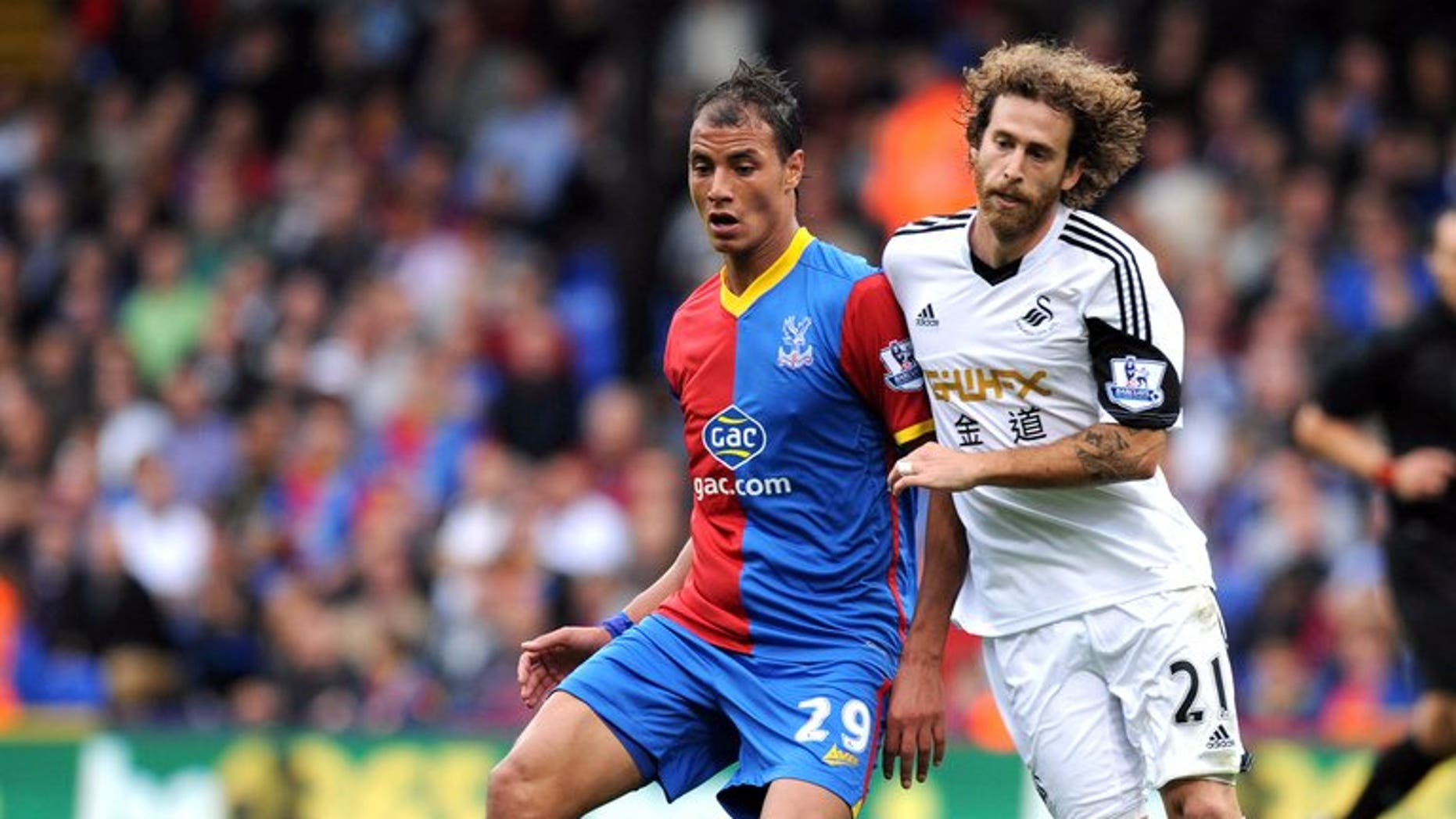 Crystal Palace's Marouane Chamakh and Swansea City's Jose Alberto Canas at Selhurst Park in south London on September 22, 2013. Swansea carried on from where they left off in Europe with a 2-0 Premier League win away to strugglers Crystal Palace on Sunday.
