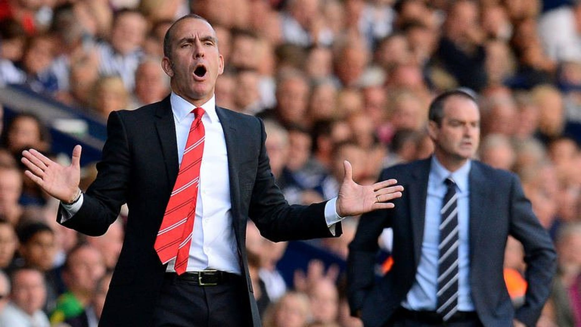 Sunderland manager Paolo Di Canio (L) reacts during the English Premier League football match between West Bromwich Albion and Sunderland at The Hawthorns in West Bromwich, central England, on September 21, 2013. West Bromwich Albion won 3-0.
