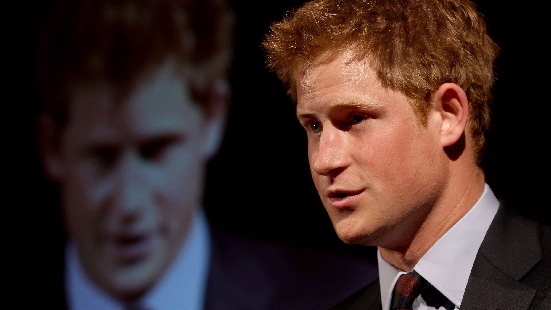 Britain's Prince Harry makes a speech at the Friends of the Forces Awards in London on July 13, 2010. The royal will visit Australia next month for events in Sydney marking the Royal Australian Navy's centenary of service, Australian Prime Minister Tony Abbott has said.
