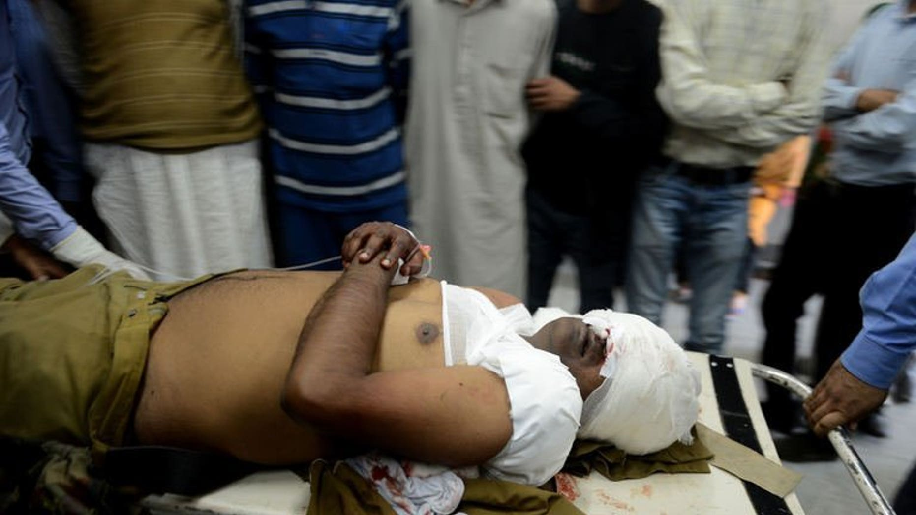 An injured Indian Central Industrial Security Force (CISF) soldier is carried through a hospital in Srinagar on September 23 ,2013. Suspected militants shot and killed a paramilitary soldier and critically wounded another on Monday in a busy market in Indian Kashmir's main city of Srinagar, police said.