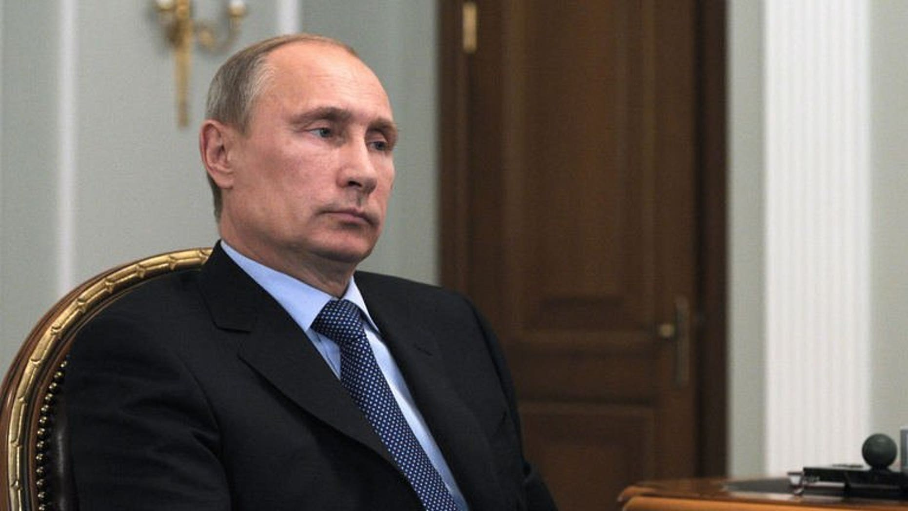 Russia's President Vladimir Putin attends a meeting in his Novo-Ogaryovo residence outside Moscow, on September 20, 2013.