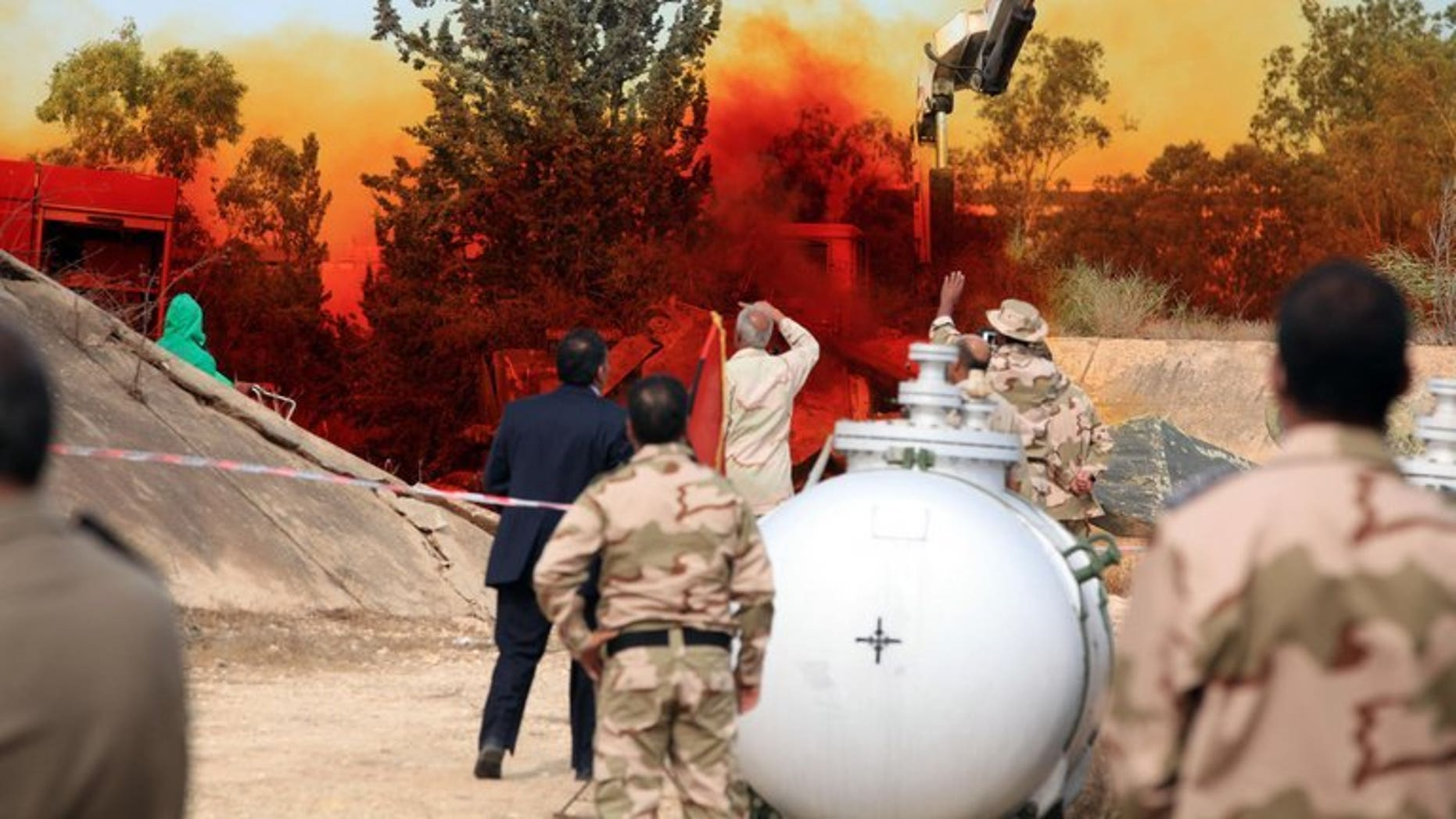 A team of Libyan experts and military engineers monitor a dump tank, under the supervision of the United Nations, in Tripoli on November 11, 2012. Experts were assigned to dump the toxic chemicals found in the air defense missiles and ammunition that was left over from the former Libyan leader Moamer Kadhafi's regime.
