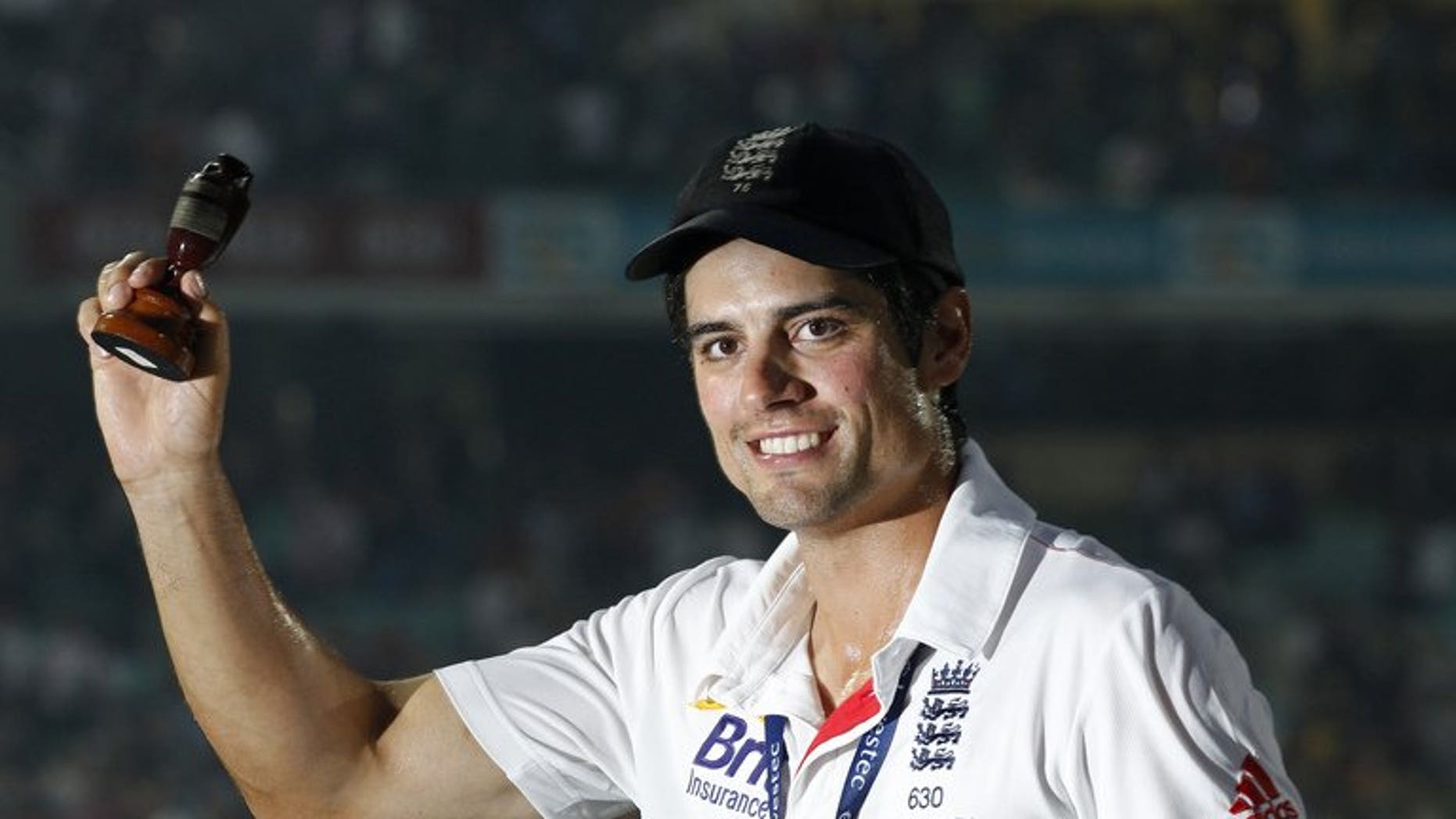 England captain Alastair Cook celebrates with a replica of the Ashes urn after the fifth Test against Australia at The Oval in London, on August 25, 2013. Yorkshire batsman Gary Ballance admits he was taken aback by his inclusion in England's squad for the forthcoming Ashes tour of Australia but insisted he was prepared for the challenge ahead.
